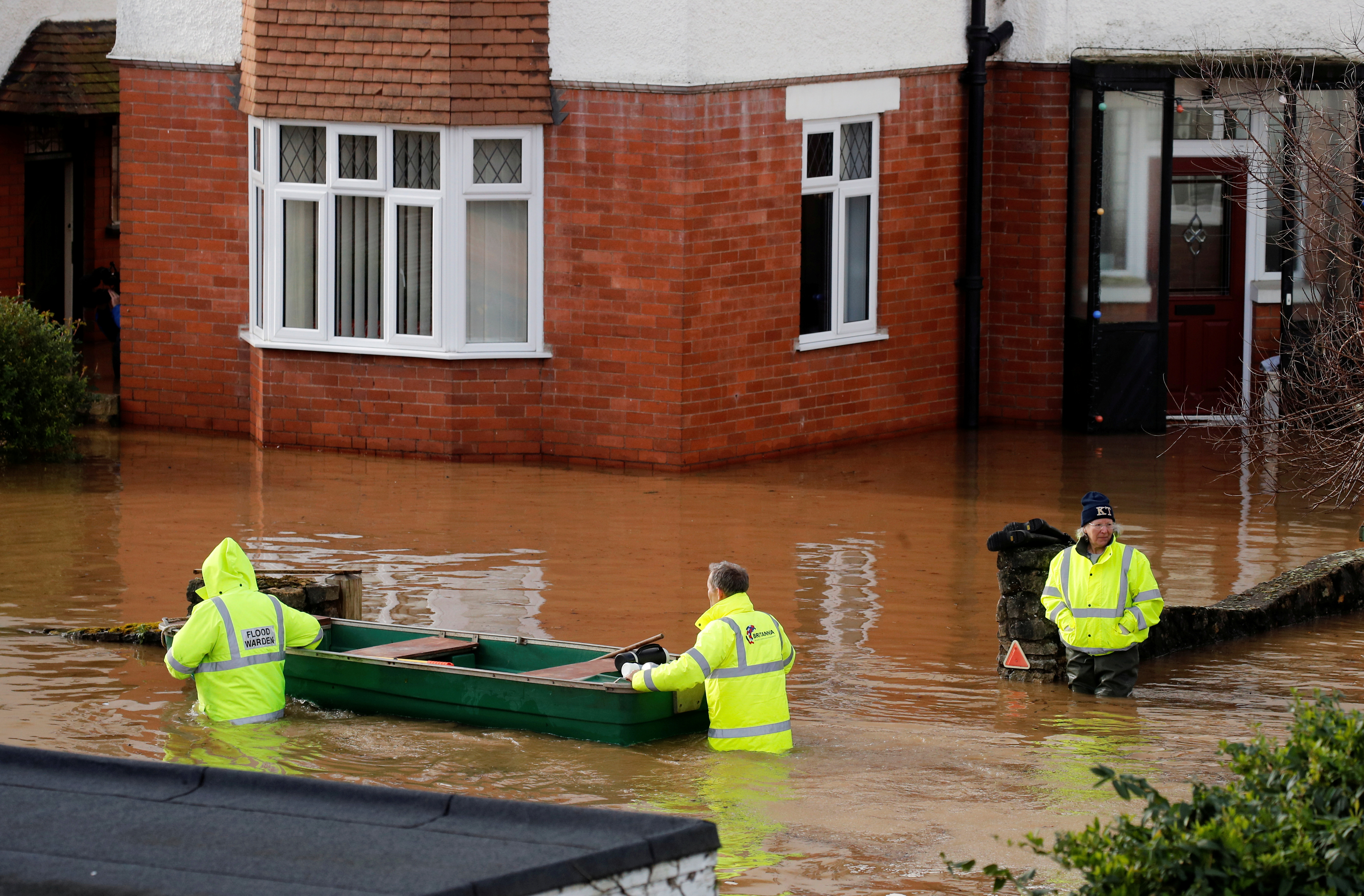 Emergency personnel look for people to rescue in a flooded street after Storm Dennis in Hereford, Britain February 17, 2020. REUTERS/Phil Noble/File Photo