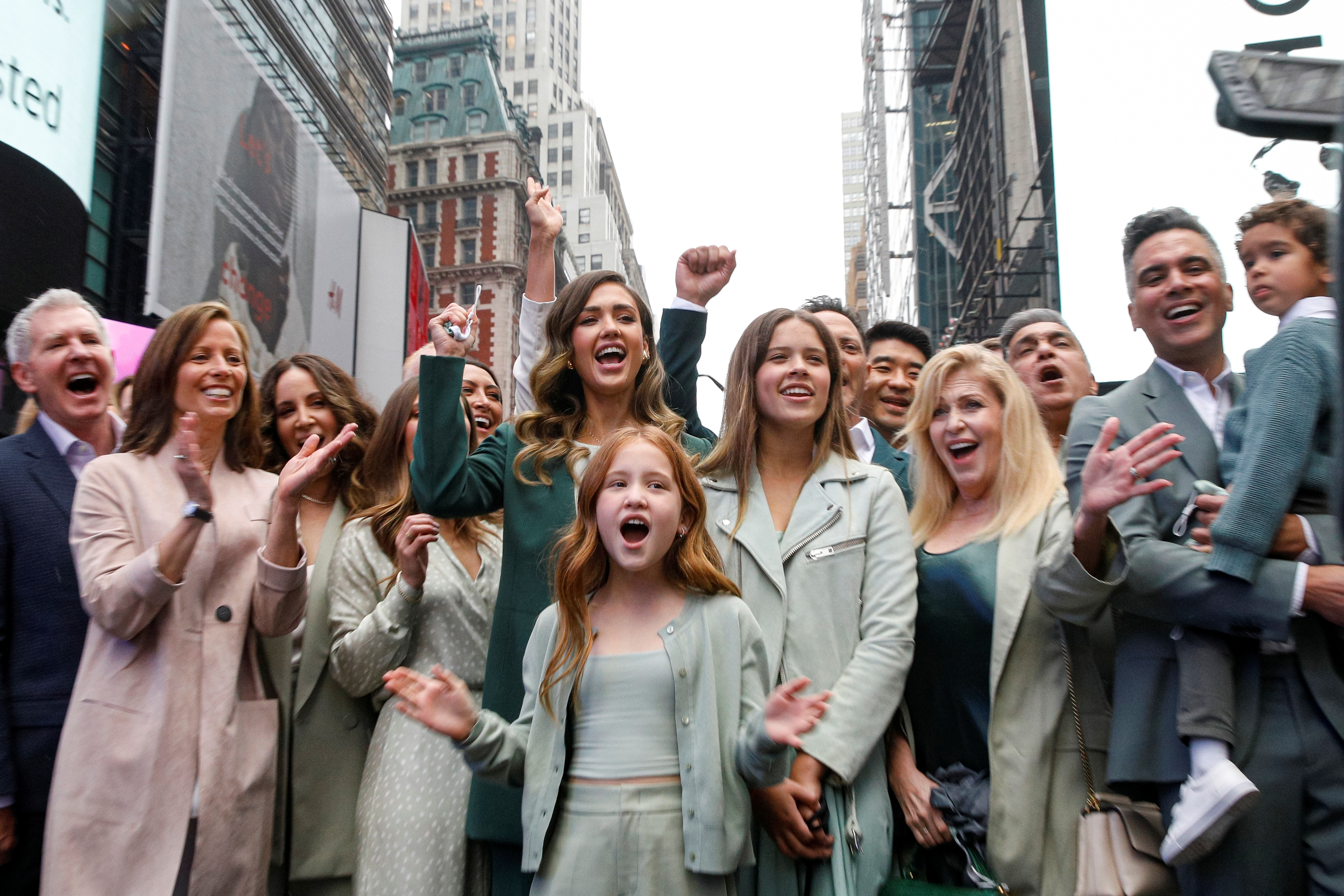 Jessica Alba, actor and businesswoman, poses for photographers with guests and family during the IPO of The Honest Company at the Nasdaq Market site in Times Square in New York City, U.S., May 5, 2021.  REUTERS/Brendan McDermid