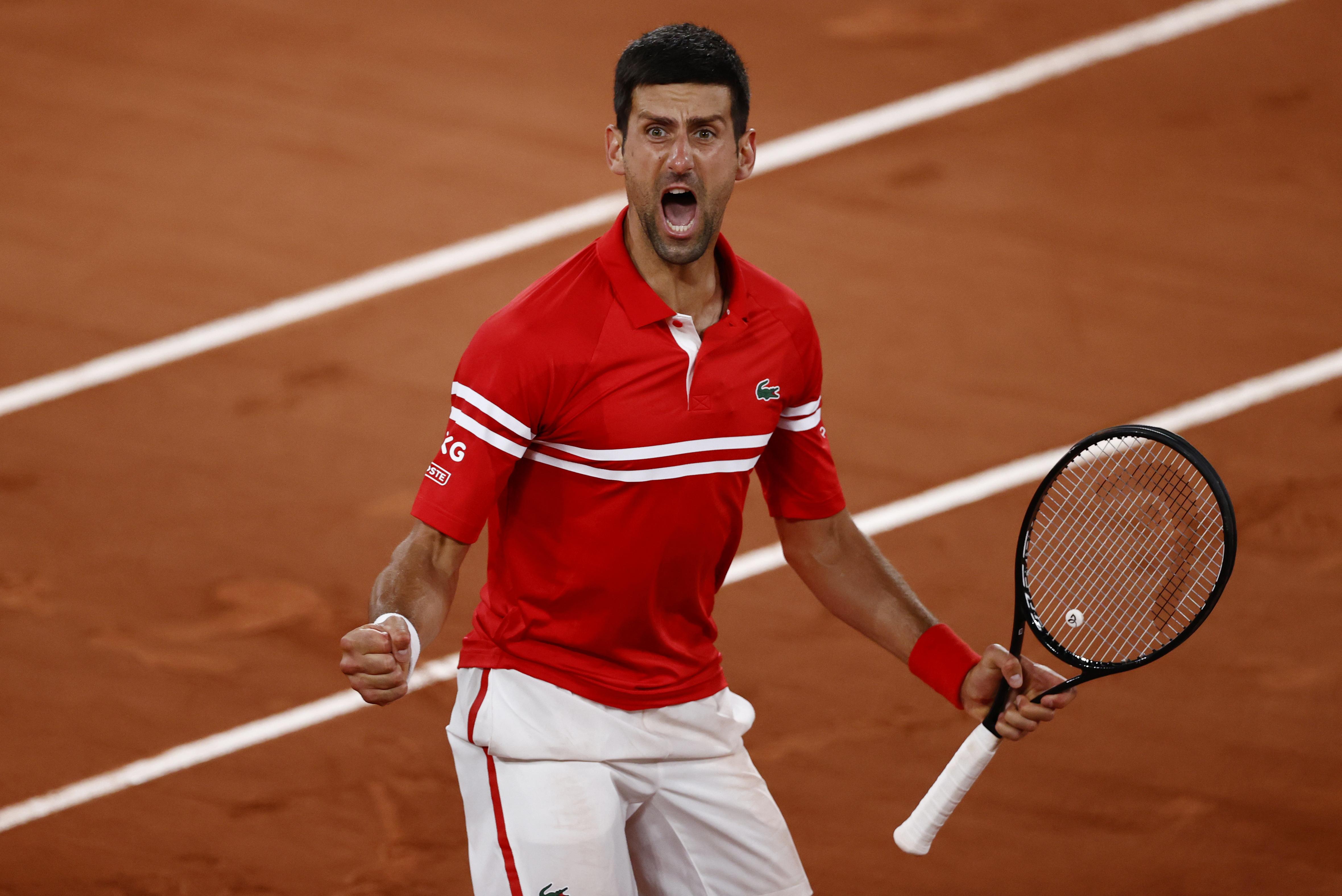 Tennis - French Open - Roland Garros, Paris, France - June 9, 2021  Serbia's Novak Djokovic celebrates winning his quarter final match against Italy's Matteo Berrettini REUTERS/Christian Hartmann