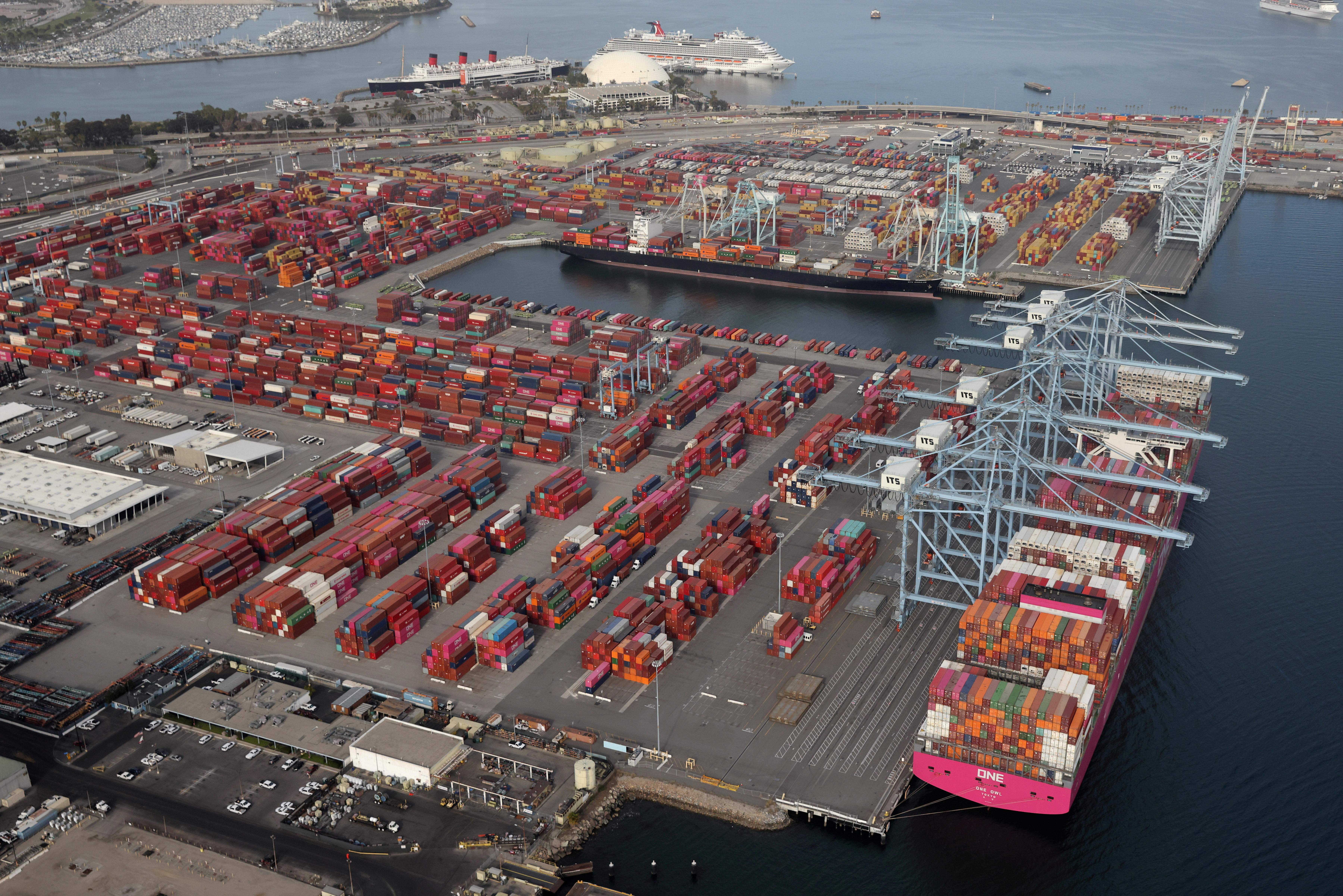 Shipping containers are unloaded from ships at a container terminal at the Port of Long Beach-Port of Los Angeles complex, amid the coronavirus disease (COVID-19) pandemic, in Los Angeles, California, U.S., April 7, 2021. REUTERS/Lucy Nicholson/File Photo