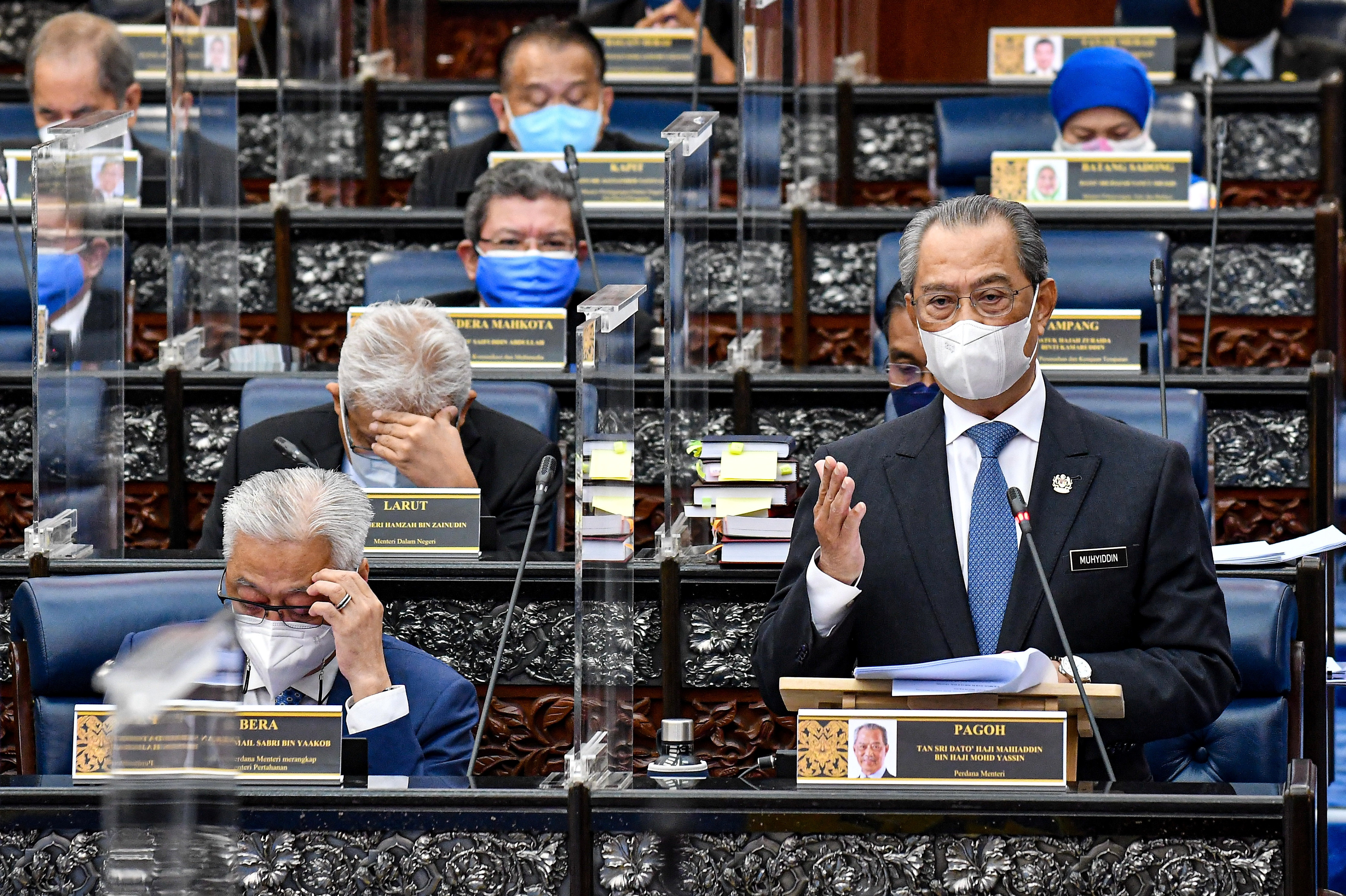 Malaysia S Embattled Pm Tries To Appease King Allies Up Pressure Reuters
