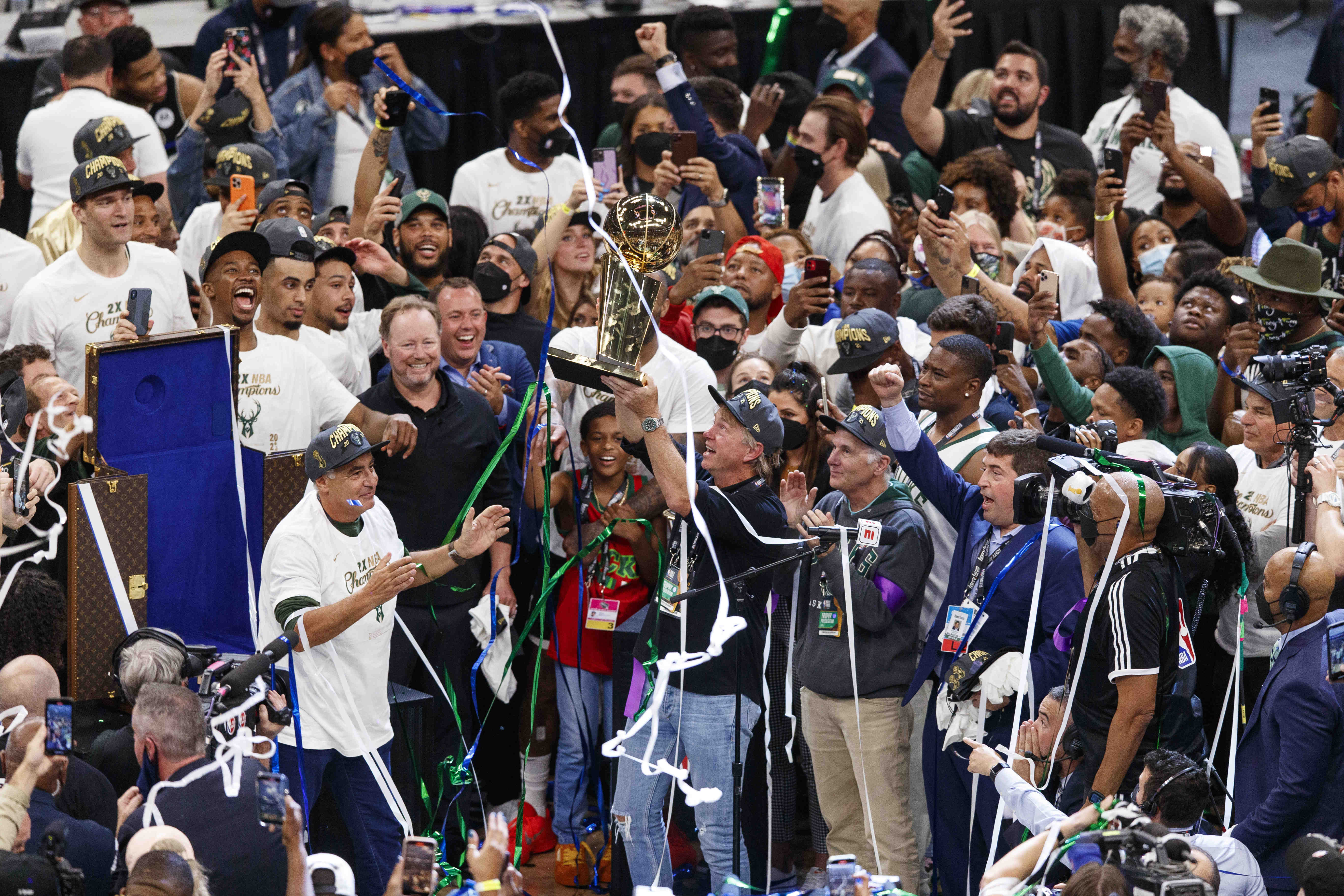 Jul 20, 2021; Milwaukee, Wisconsin, USA; Milwaukee Bucks owner Wes Edens holds up the Larry OÕBrien trophy following game six of the 2021 NBA Finals against the Phoenix Suns at Fiserv Forum. Mandatory Credit: Jeff Hanisch-USA TODAY Sports