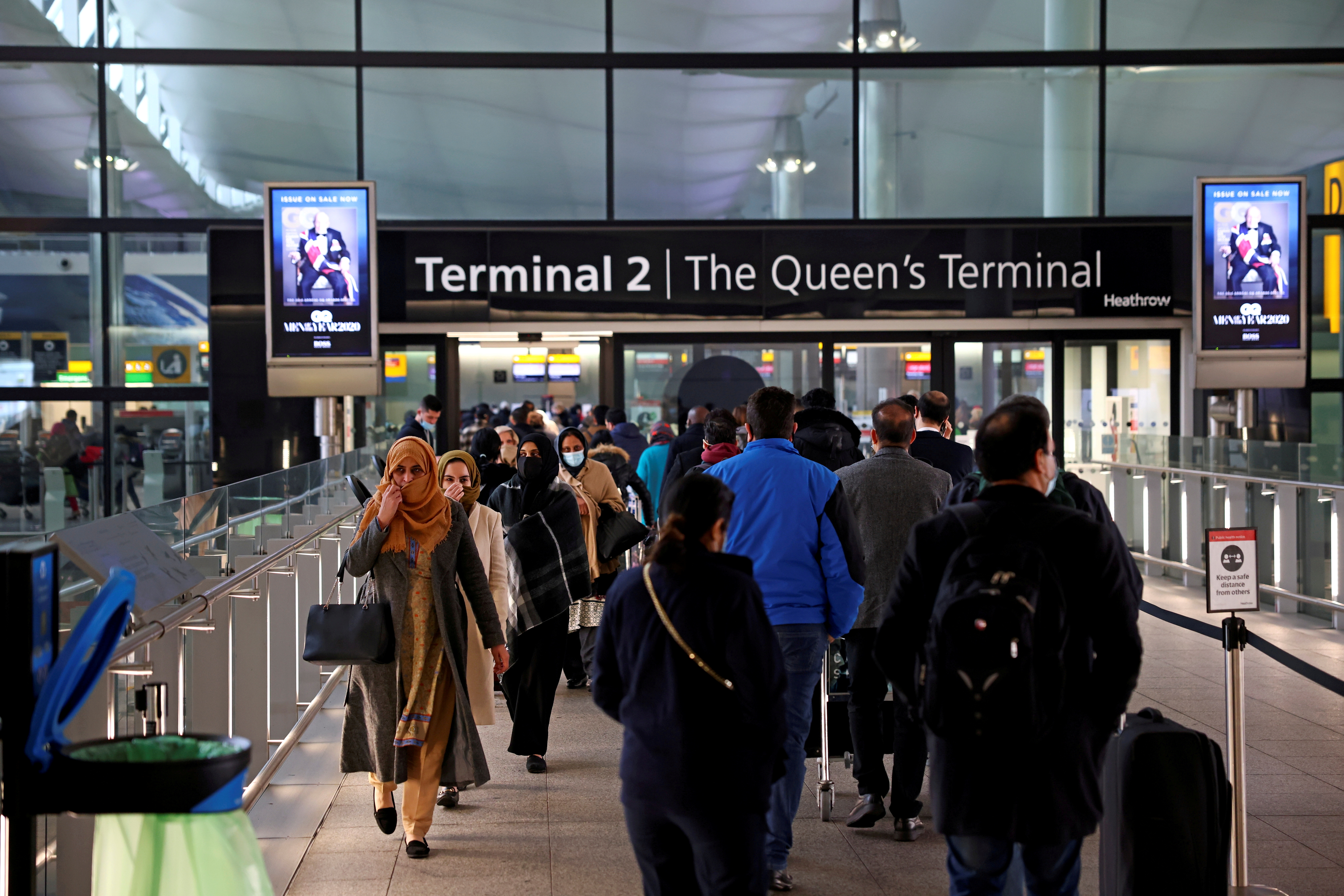 People queue to enter terminal 2, as tighter rules for international travellers start, at Heathrow Airport, amid the spread of the coronavirus disease (COVID-19) pandemic, London, Britain, January 18, 2021. REUTERS/Henry Nicholls