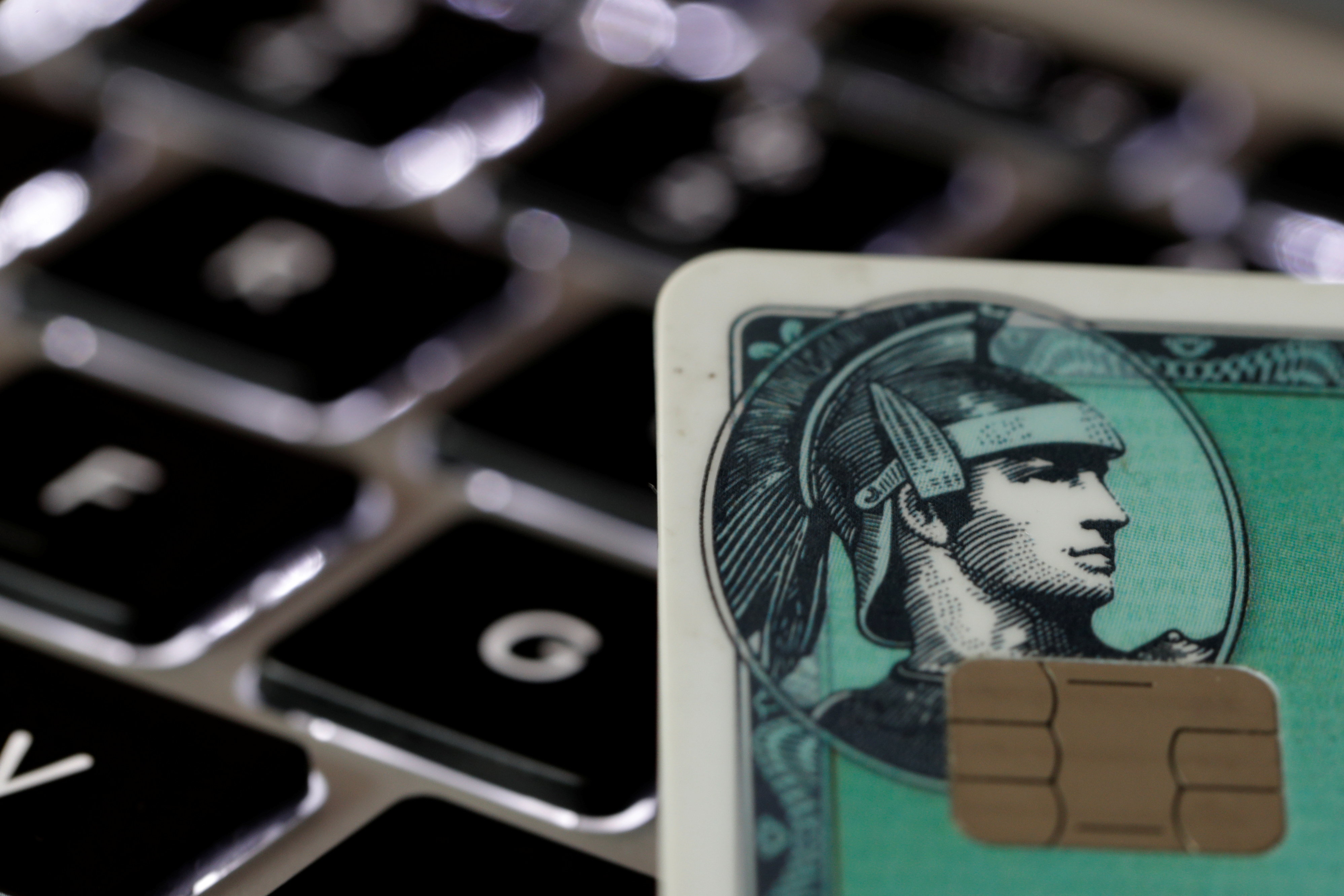 An American Express credit card is seen on a computer keyboard in this picture illustration taken September 6, 2017. REUTERS/Philippe Wojazer/Illustration
