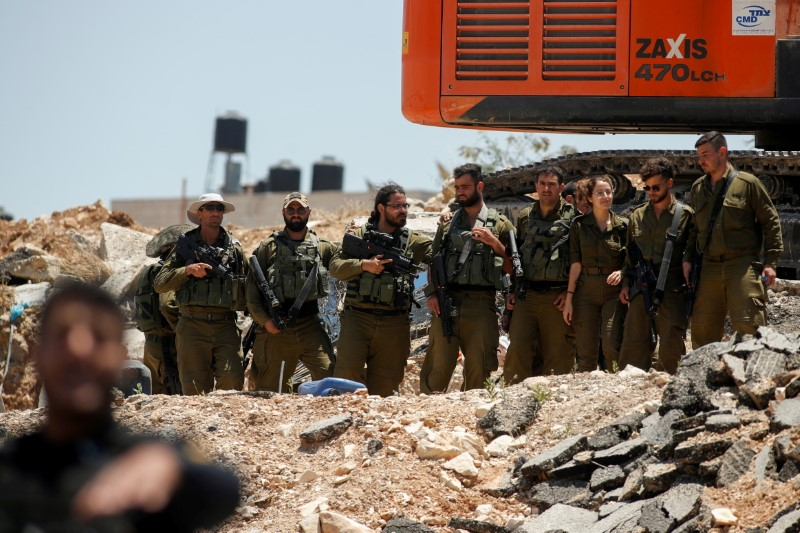 Members of Israeli forces gather near the scene of a security incident near Hizma checkpoint in the Israeli-occupied West Bank, June 16, 2021. REUTERS/Mohamad Torokman