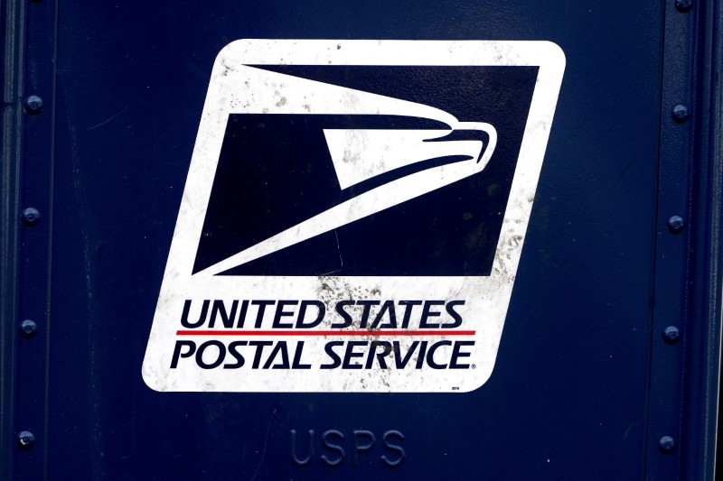 A U.S. Postal Service (USPS) logo is pictured on a mail box in the Manhattan borough of New York City, New York, U.S., August 21, 2020. REUTERS/Carlo Allegri/File Photo