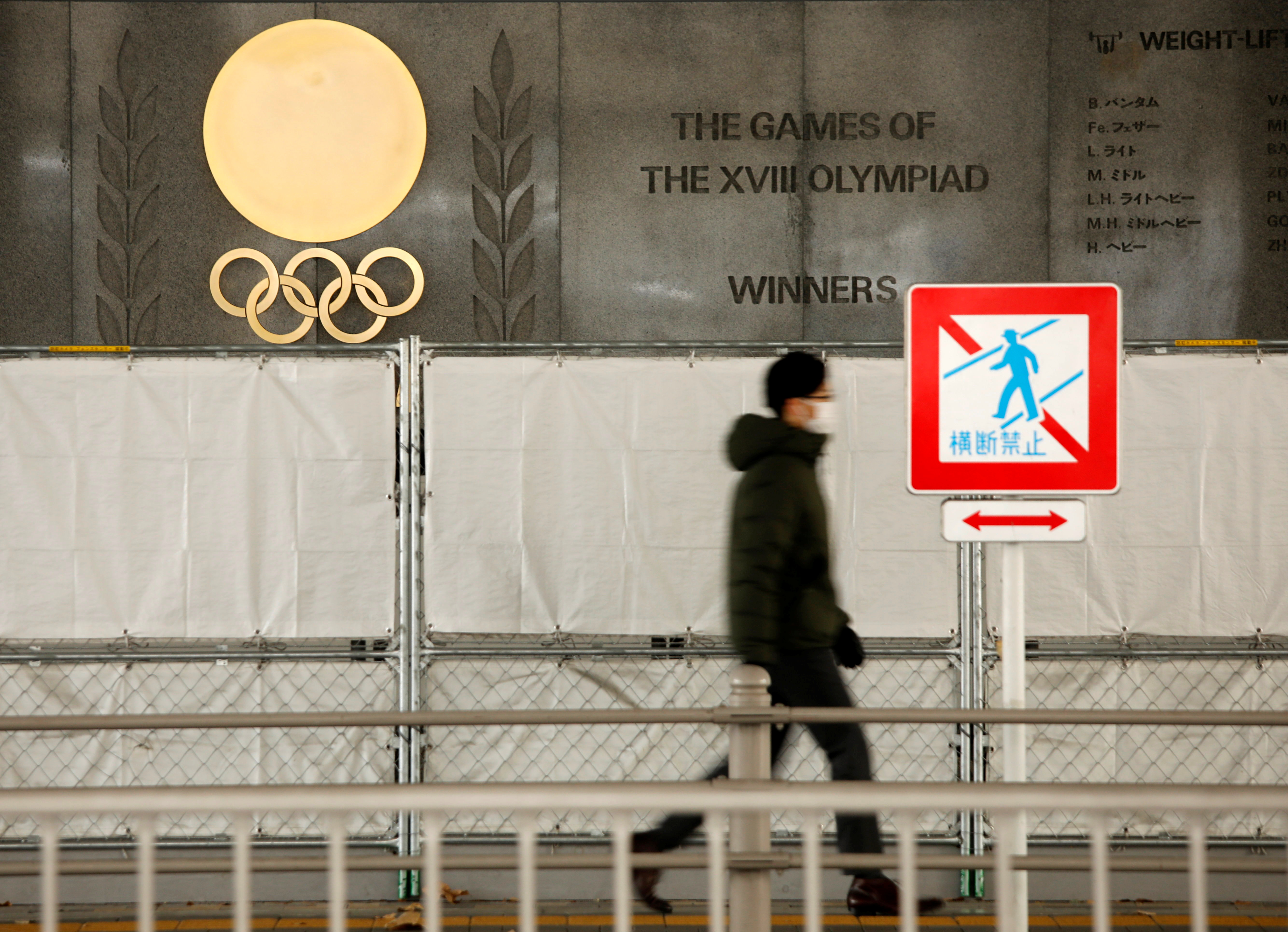 Olympic rings are seen outside the National Stadium, the main venue for the 2020 Olympic and Paralympic Games in Tokyo, Japan January 8, 2021.  REUTERS/Issei Kato
