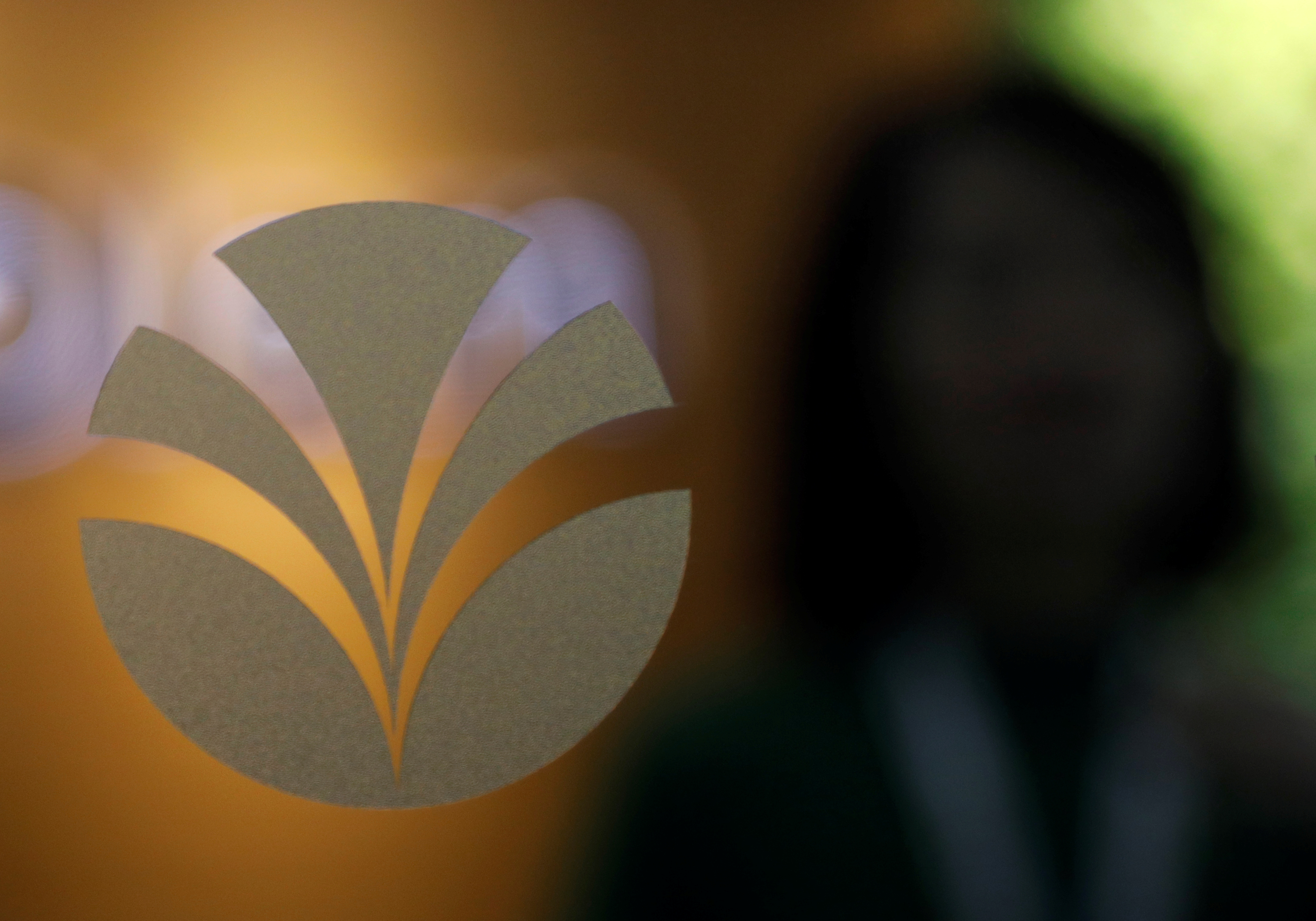 An Olam logo is pictured in their office in Singapore August 14, 2017. REUTERS/Edgar Su/File Photo