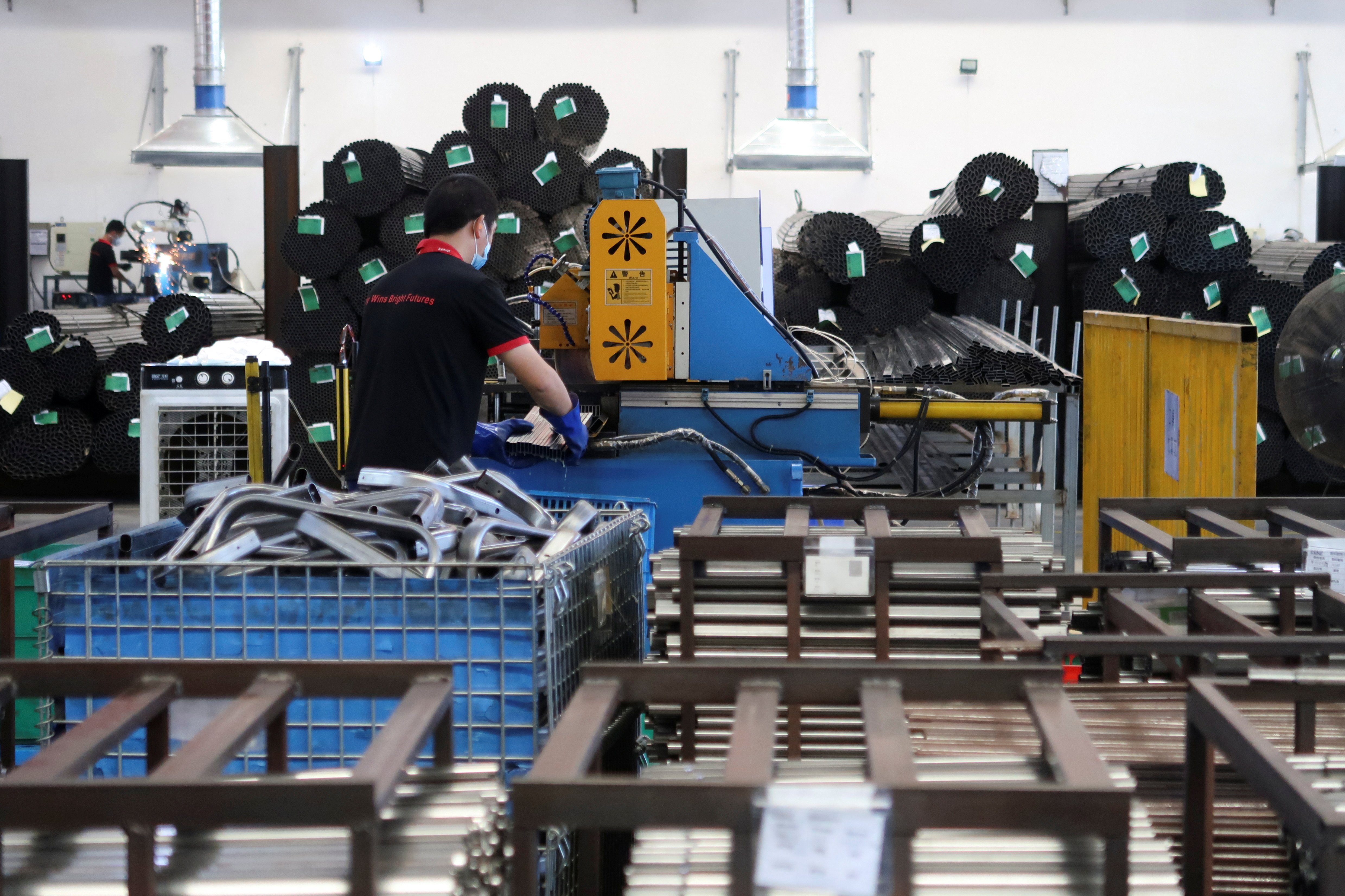 Employees work on the production line of American infant product and toy manufacturer Kids II Inc. at a factory in Jiujiang, Jiangxi province, China June 22, 2021. REUTERS/Gabriel Crossley