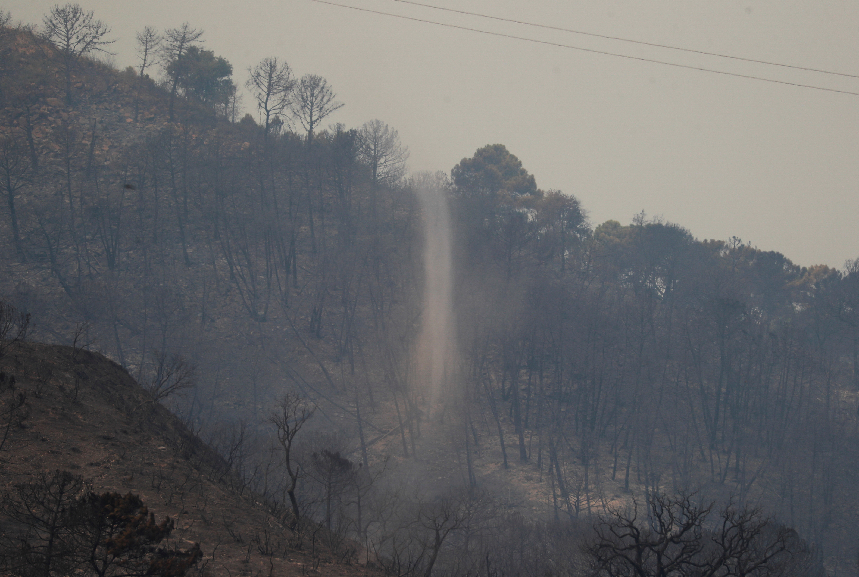 A whirlwind is seen amid a burned area on the Sierra Bermeja mountain in Estepona, Spain, September 9, 2021. REUTERS/Jon Nazca
