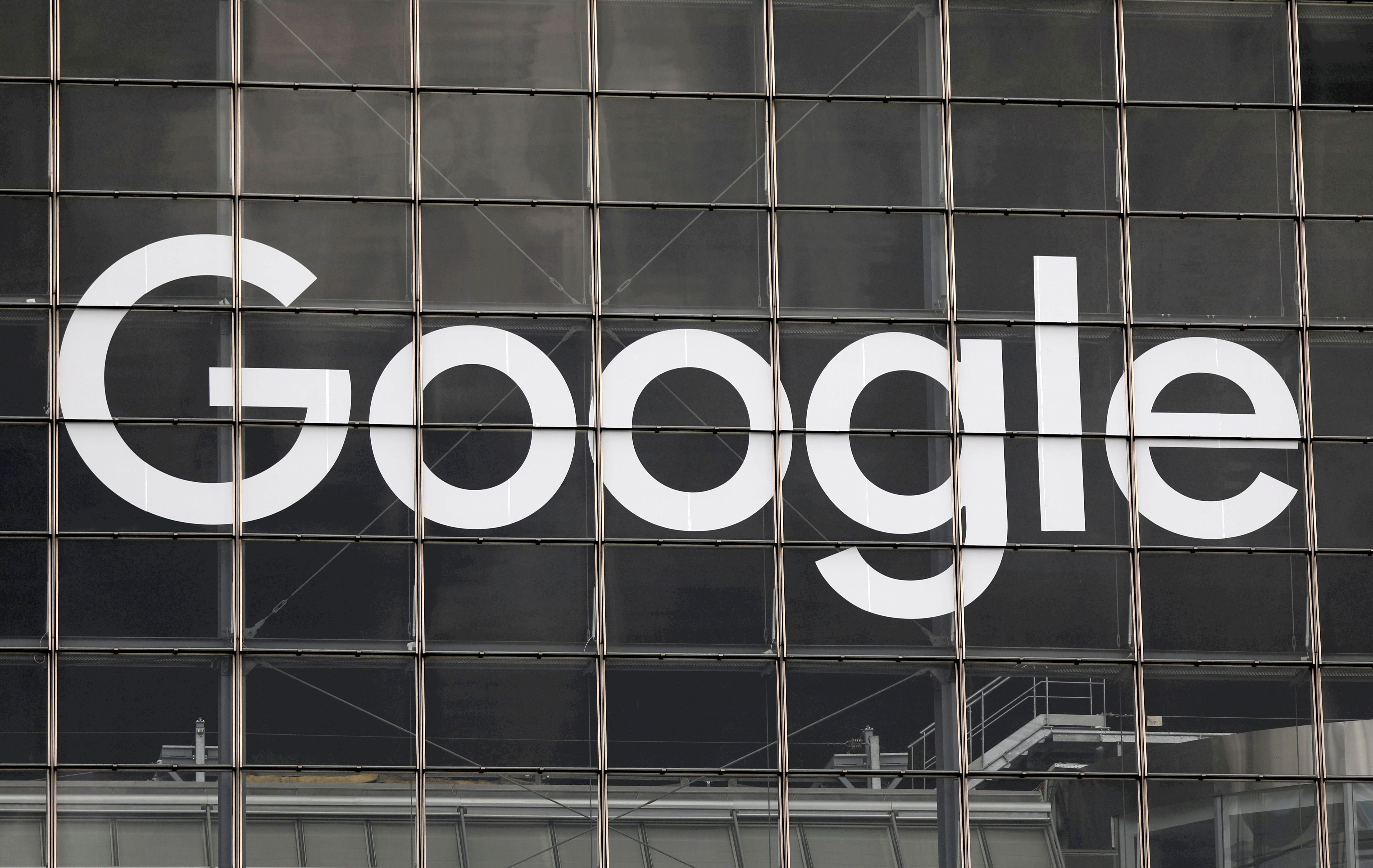 The logo of Google is seen on a building at La Defense business and financial district in Courbevoie near Paris, France, September 1, 2020.  REUTERS/Charles Platiau/File Photo
