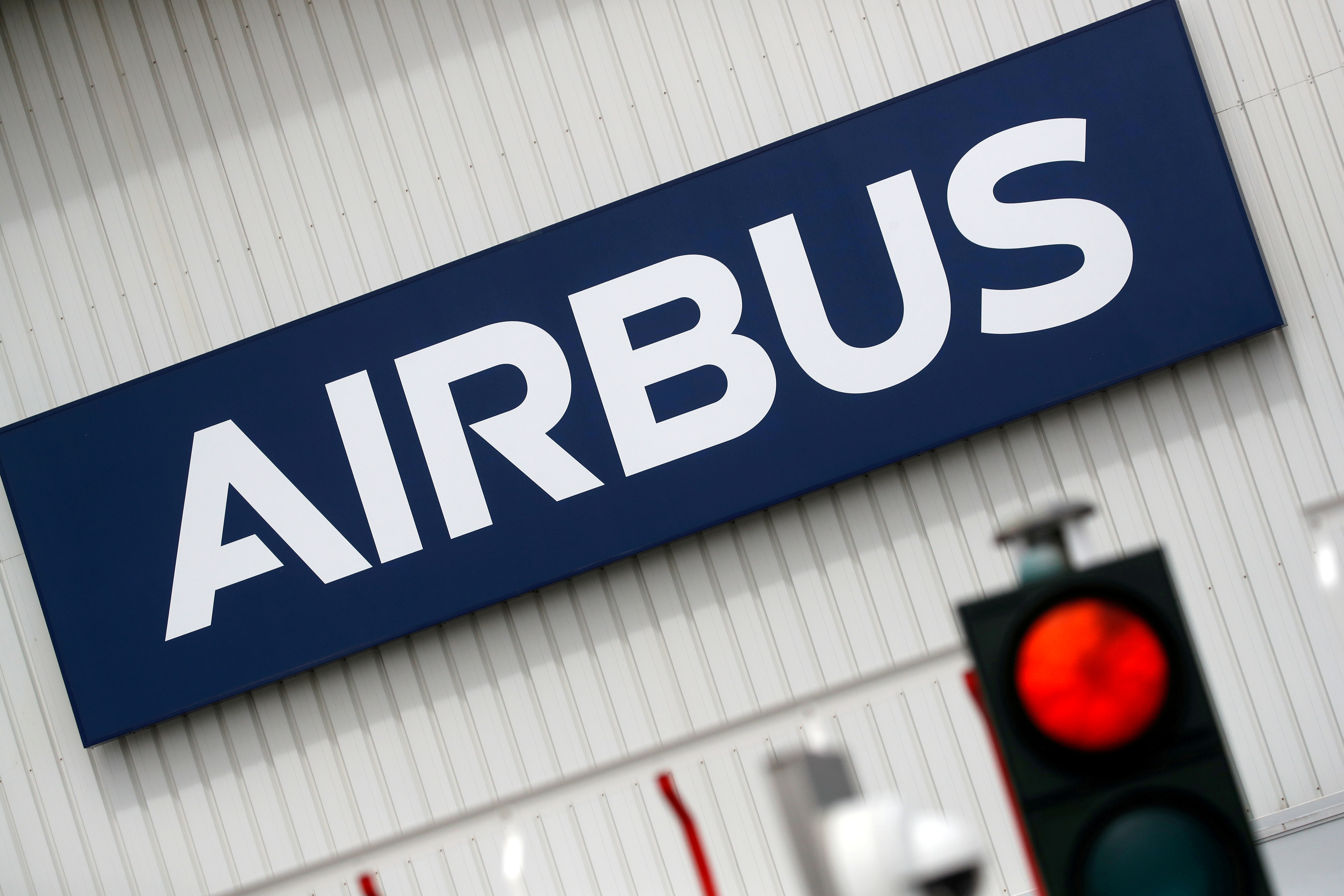 The logo of Airbus is pictured at the entrance of the Airbus facility in Bouguenais, near Nantes, France, July 2, 2020. REUTERS/Stephane Mahe/File Photo