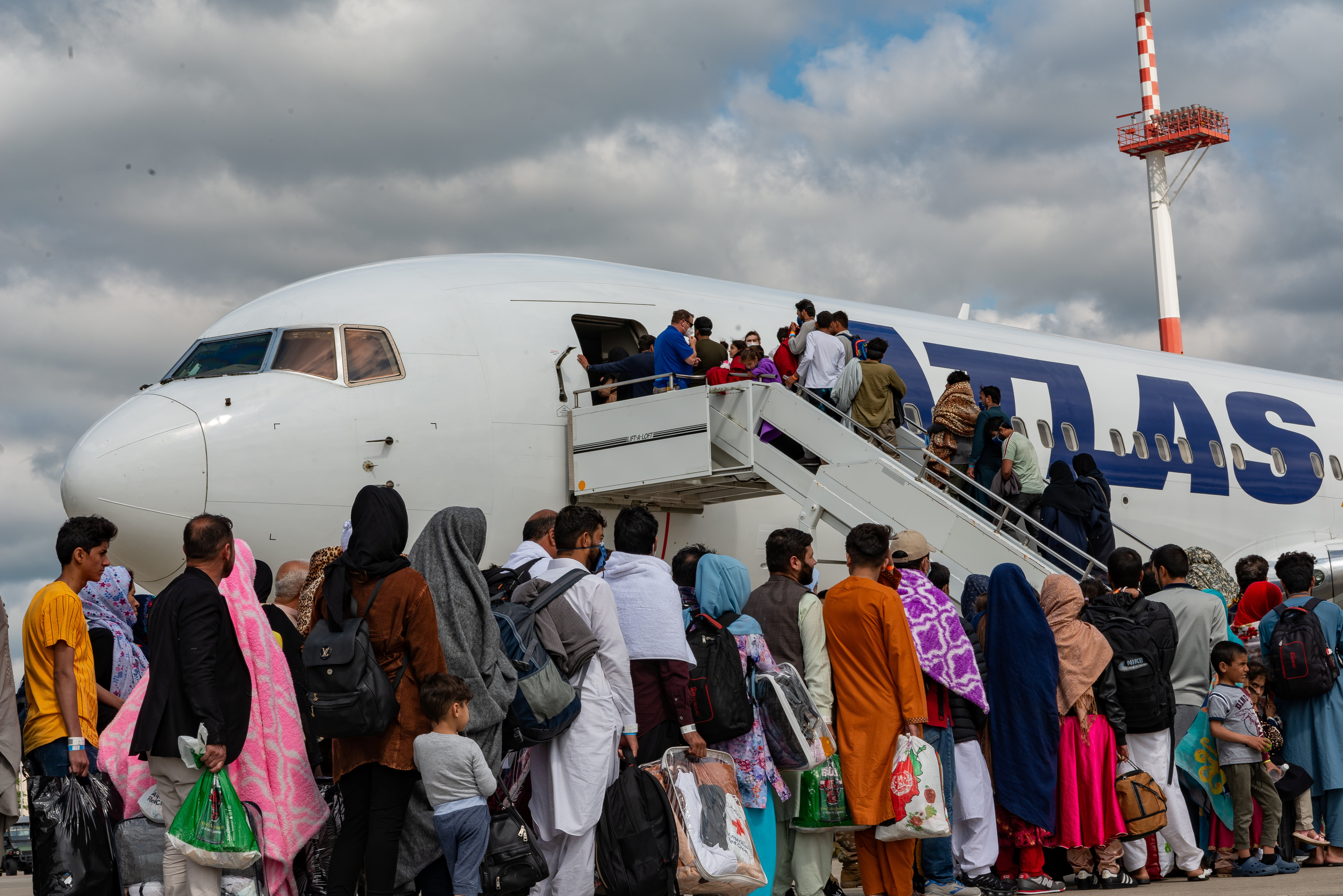 Evacuees from Afghanistan board an Atlas Air aircraft for a departure flight on their way to the United States as part of Operations Allies Refuge, at Ramstein Air Base, Germany, August 24, 2021.  U.S. Air Force/Airman Edgar Grimaldo/Handout via REUTERS