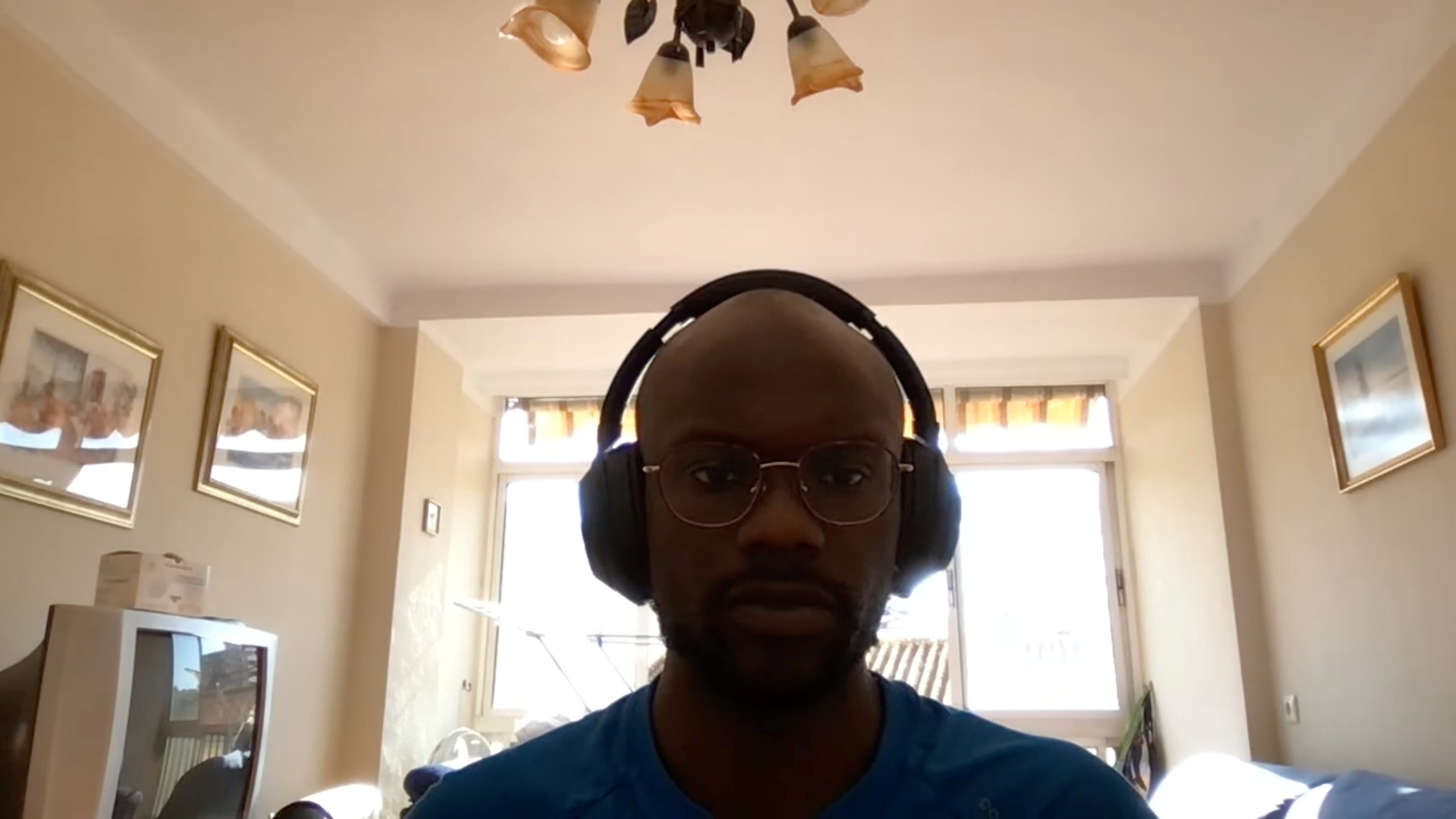 A screengrab dated June 2, 2021 shows a user during a Google Meet video call appearing underexposed because of the stark contrast in light between the foreground and background. Google/Handout via REUTERS