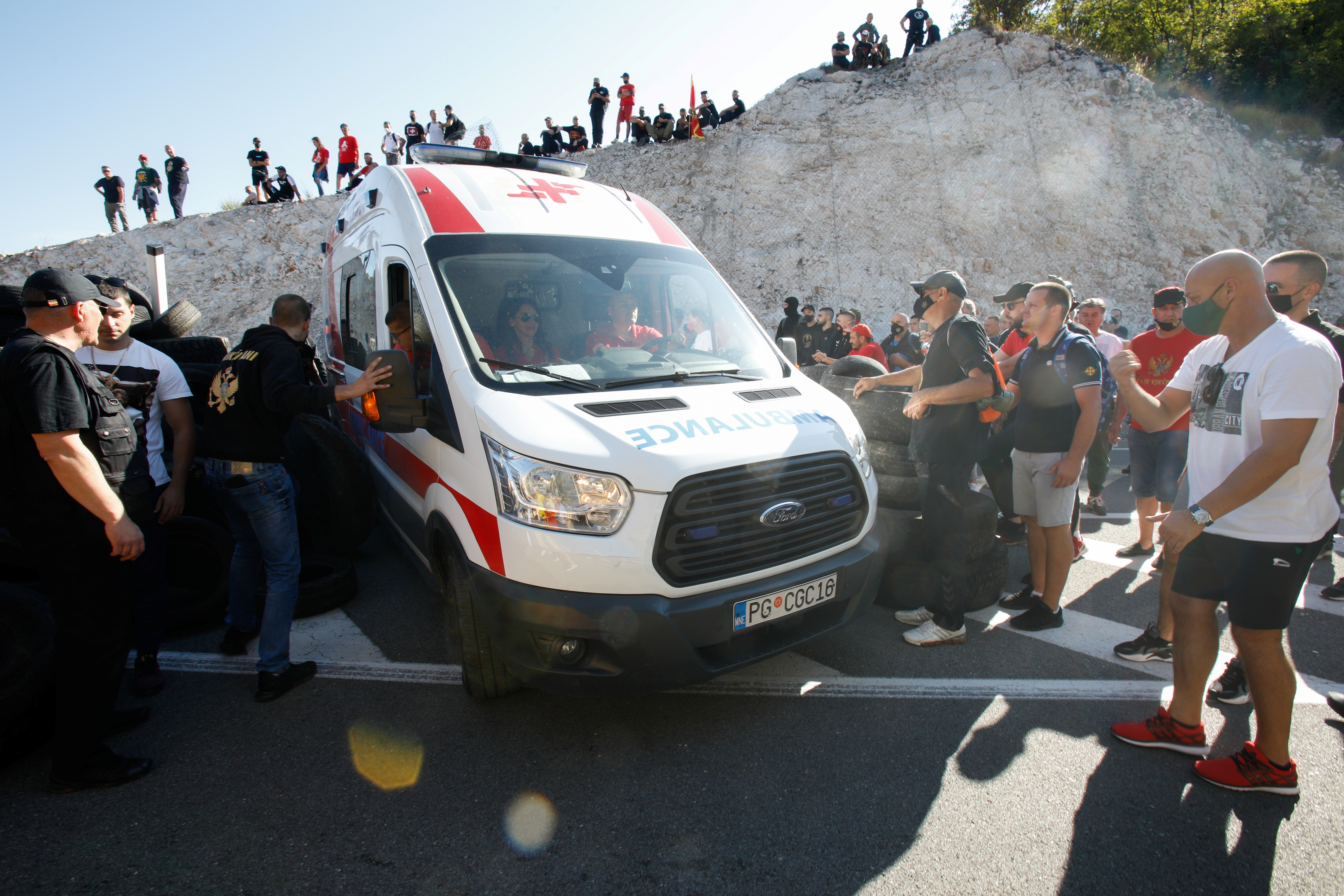 An ambulance attends the place where demonstrators participate in a protest against the enthronement of Bishop Joanikije in Cetinje, Montenegro, September 4, 2021. REUTERS/Stevo Vasiljevic