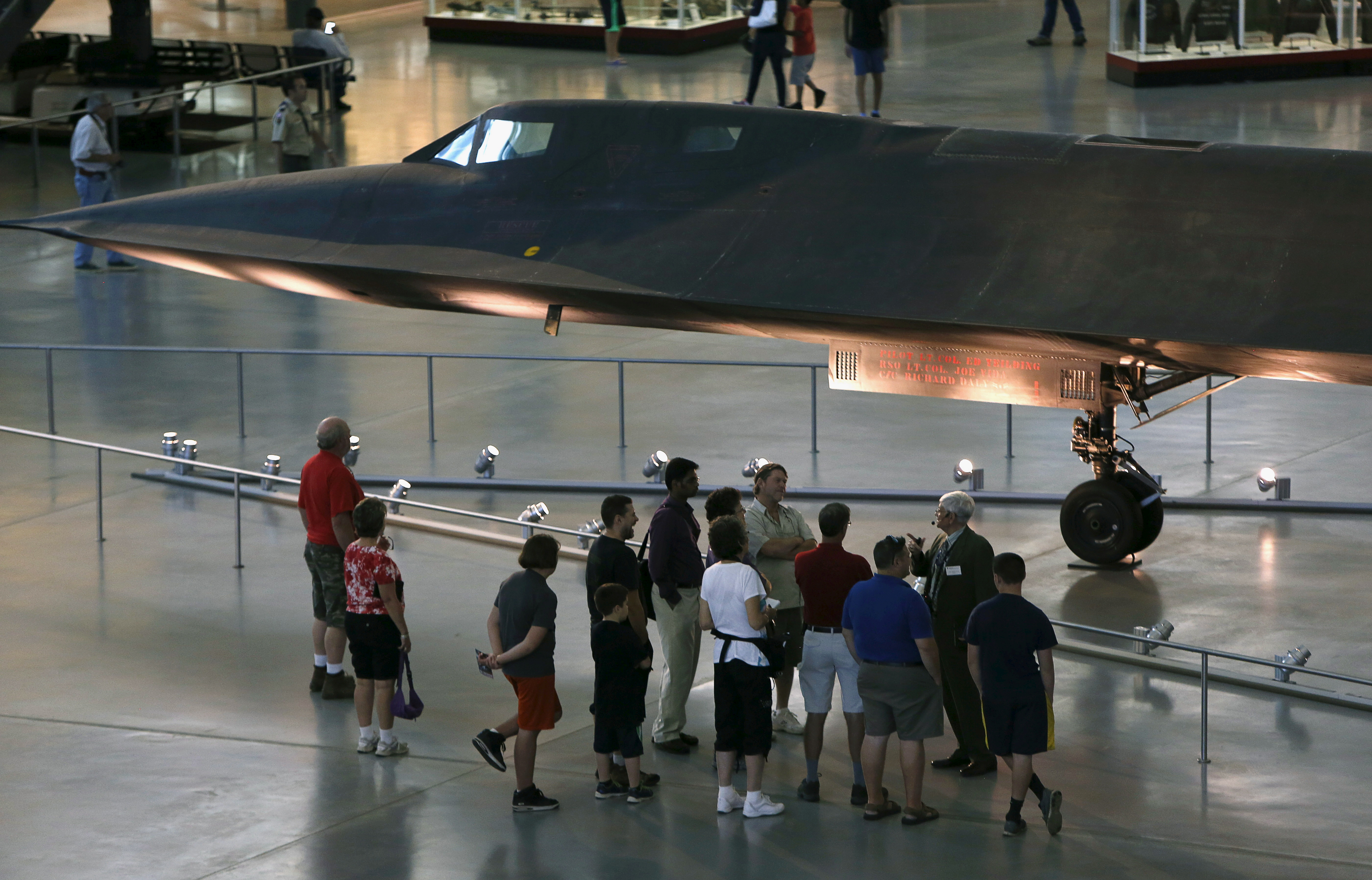 A tour group gathers under a Lockheed SR-71 Blackbird at the Udvar-Hazy Smithsonian National Air and Space Annex Museum in Chantilly, Virginia August 28, 2015. The SR-71 was a long-range spy plane that was in use from 1964 to 1998 and designed to operate at three times the speed of sound. REUTERS/Gary Cameron/