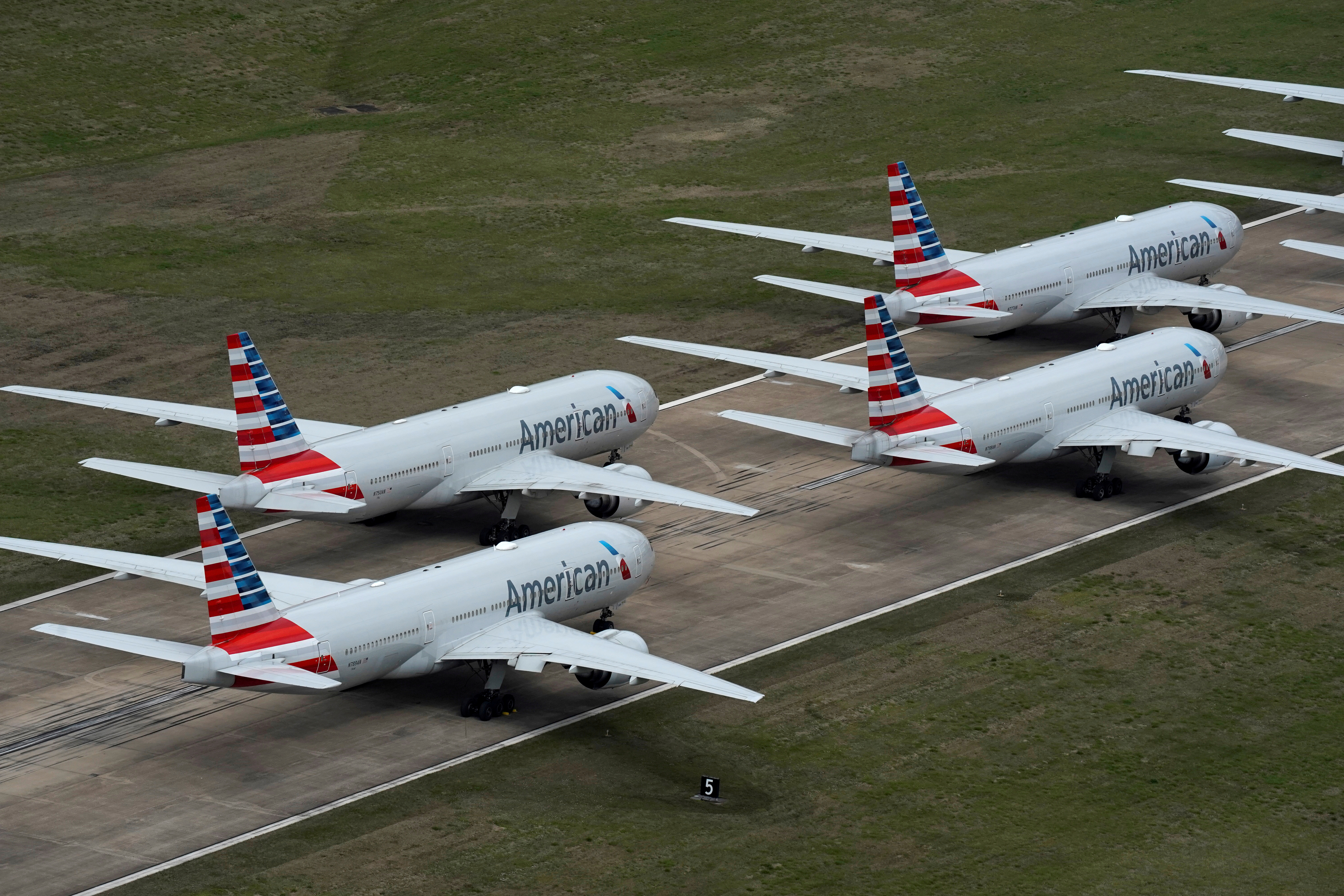 American Airlines passenger planes crowd a runway where they are parked due to flight reductions to slow the spread of coronavirus disease (COVID-19), at Tulsa International Airport in Tulsa, Oklahoma, U.S. March 23, 2020. REUTERS/Nick Oxford/File Photo