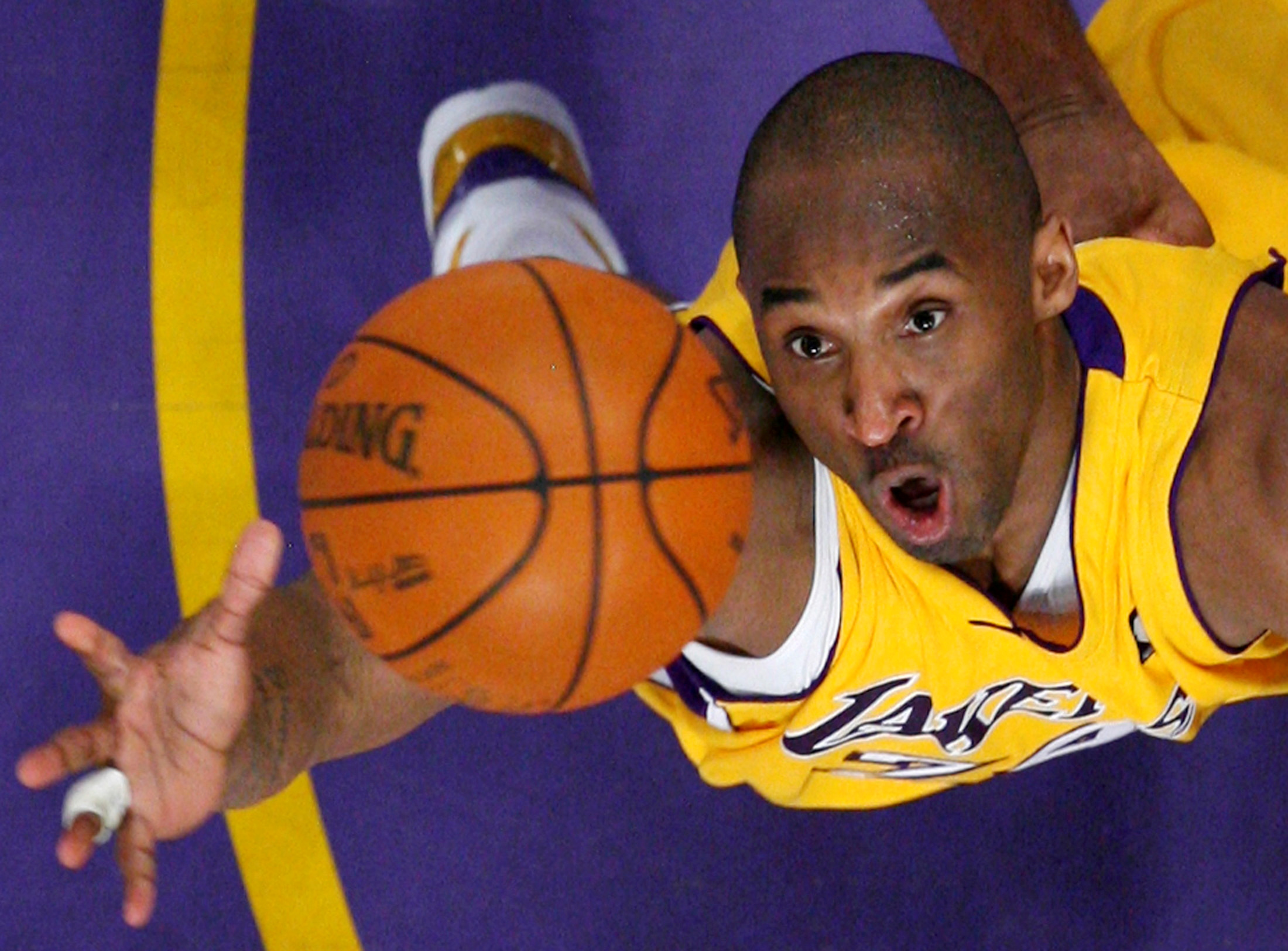 Los Angeles Lakers Kobe Bryant jumps for a rebound against the Denver Nuggets during Game 2 of their NBA Western Conference final basketball playoff game in Los Angeles, California, U.S. May 21, 2009.  REUTERS/Lucy Nicholson/File Photo