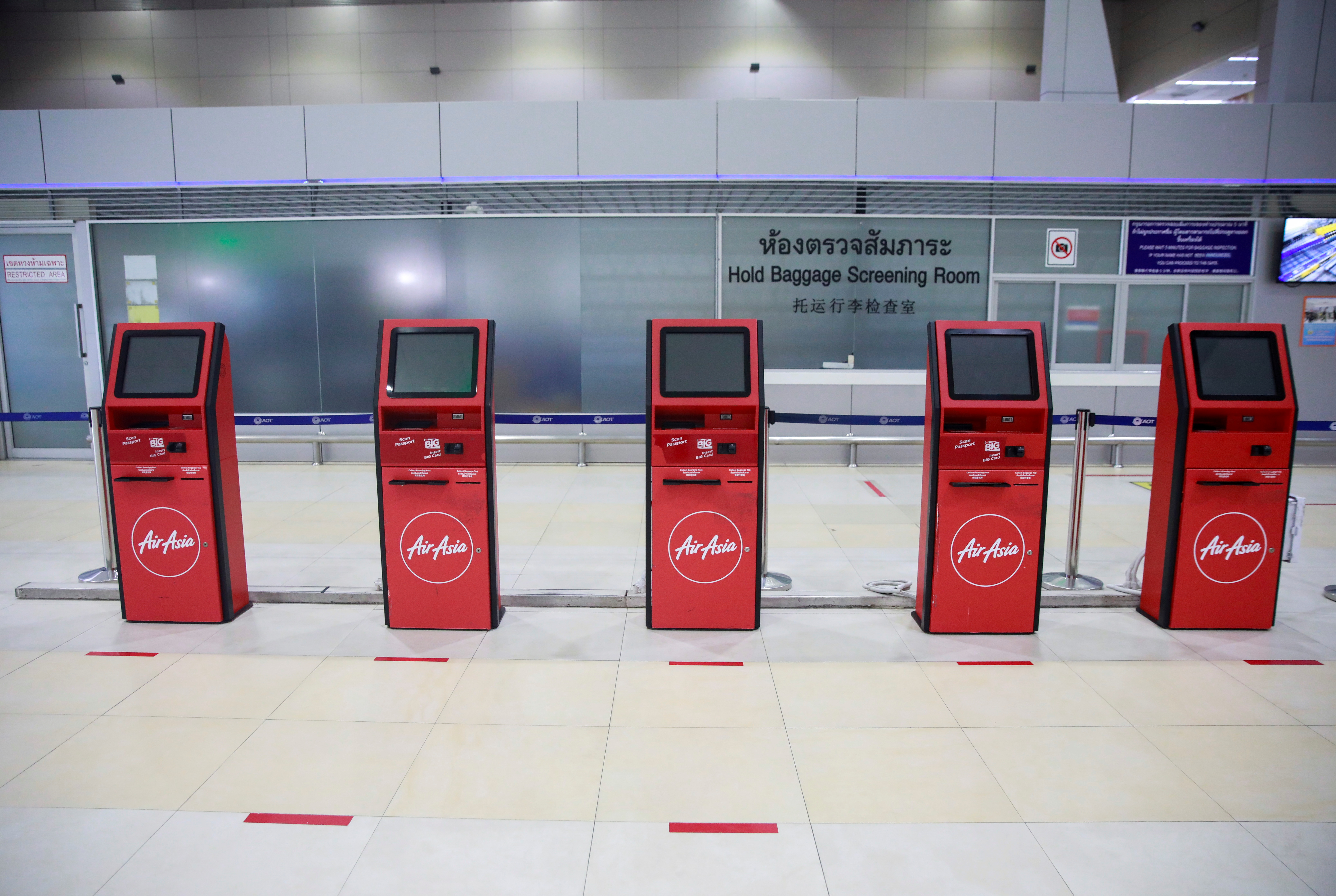 The AirAsia counter is closed as lockdown and travel restrictions are imposed to curb the spread of the coronavirus disease (COVID-19) at Don Muang Airport in Bangkok, Thailand, July 12, 2021. REUTERS/Soe Zeya Tun