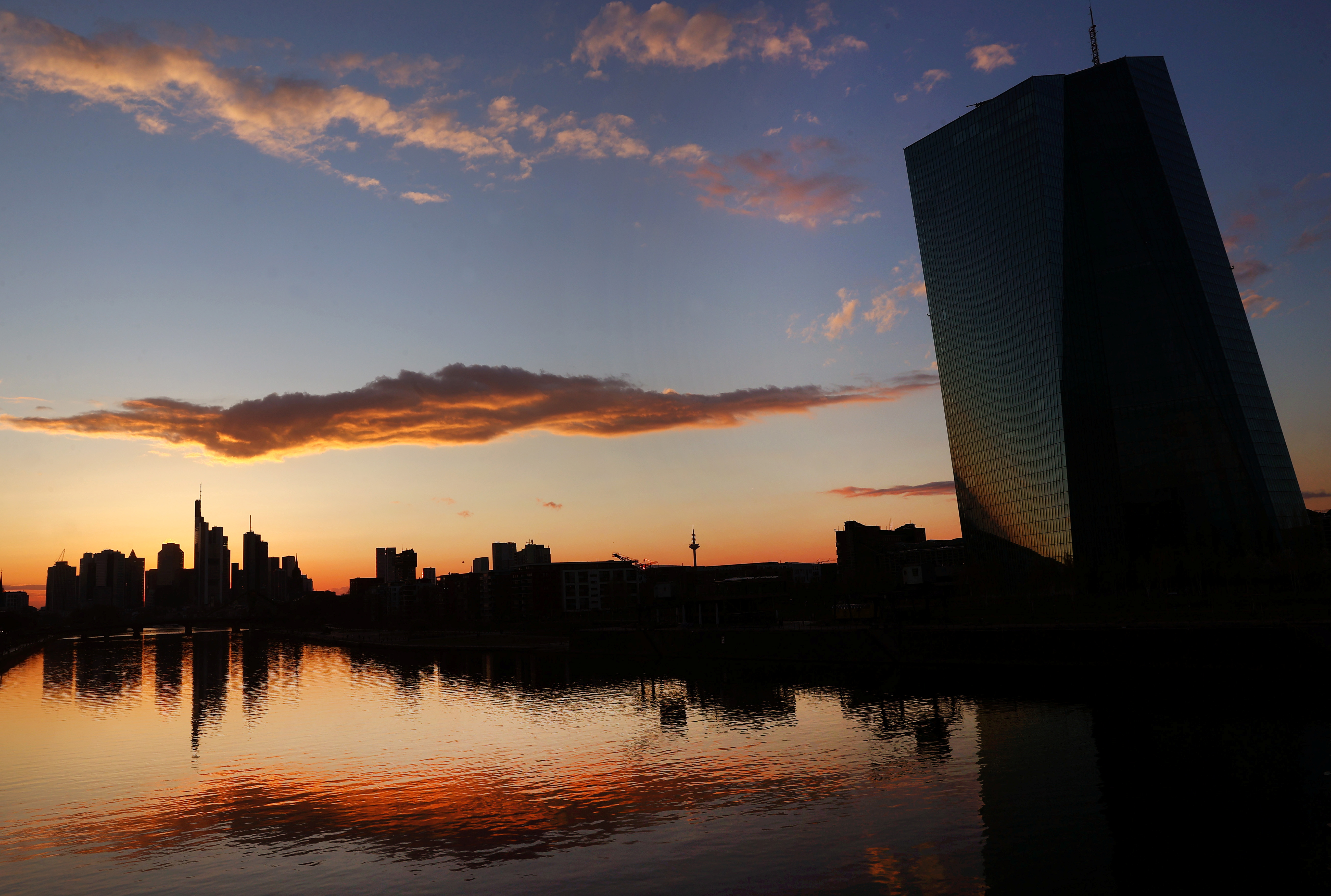 The European Central Bank (ECB) and the skyline with its financial district are photographed during sunset as the spread of the coronavirus disease (COVID-19) continues in Frankfurt, Germany, April 12, 2021.  REUTERS/Kai Pfaffenbach