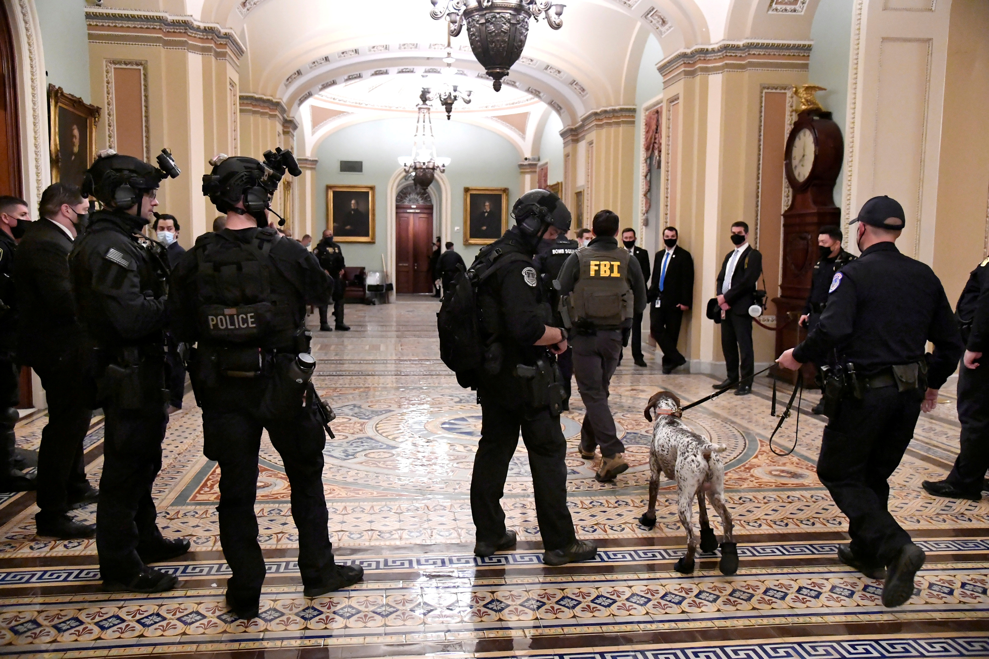 A heavy police force is evident at the Senate door after supporters of President Donald Trump breached security at the U.S. Capitol, rioting through the Senate and House and disrupting the certification of President-elect Joe Biden, in Washington, U.S. January 6, 2021. REUTERS/Mike Theiler/File Photo