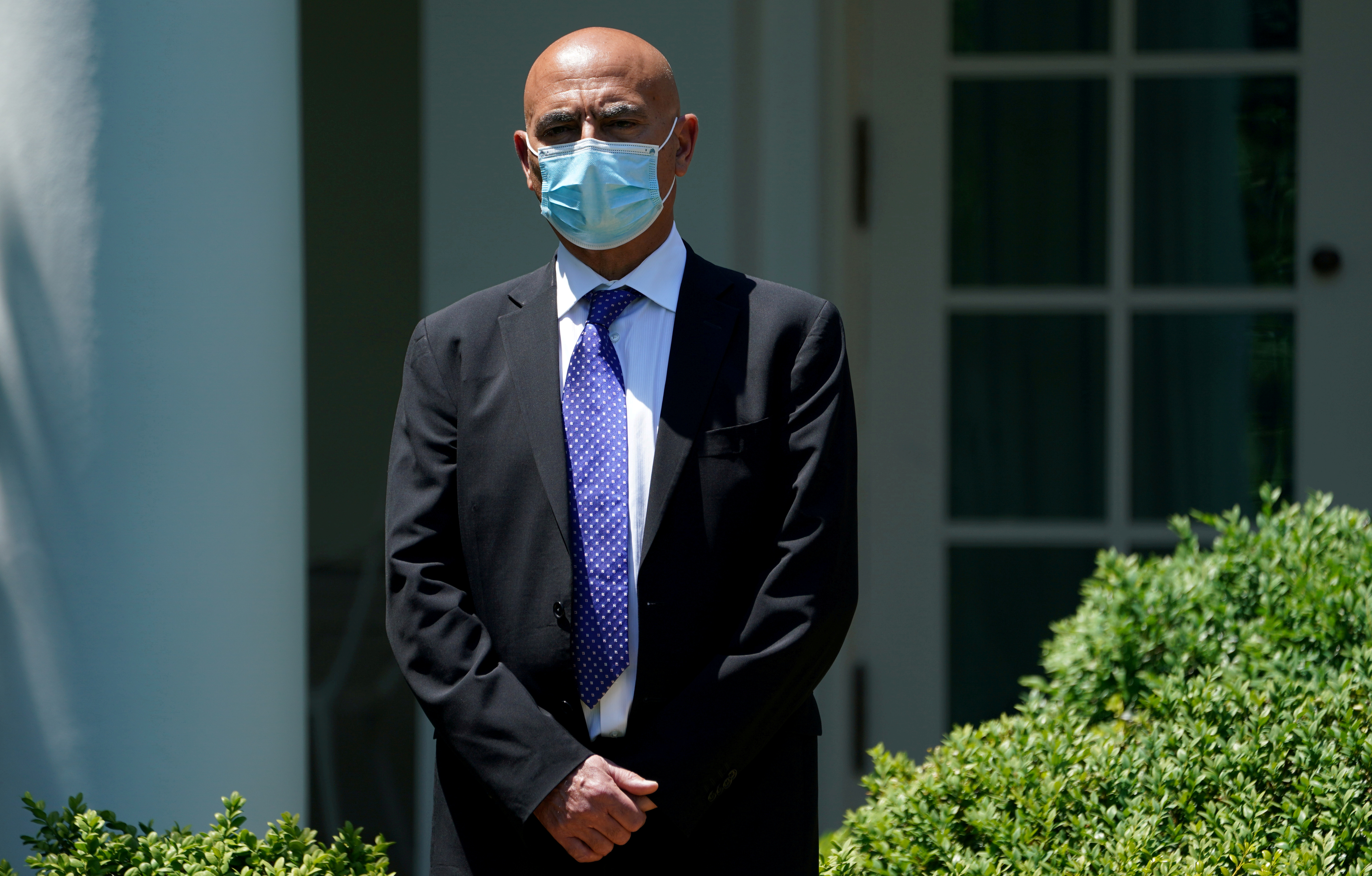 Former GlaxoSmithKline pharmaceutical executive Moncef Slaoui, who will serve as chief adviser on the effort to find a vaccine for the coronavirus disease (COVID-19) pandemic, waits to speak as President Donald Trump holds a coronavirus disease response event in the Rose Garden at the White House in Washington, U.S., May 15, 2020. REUTERS/Kevin Lamarque/File Photo