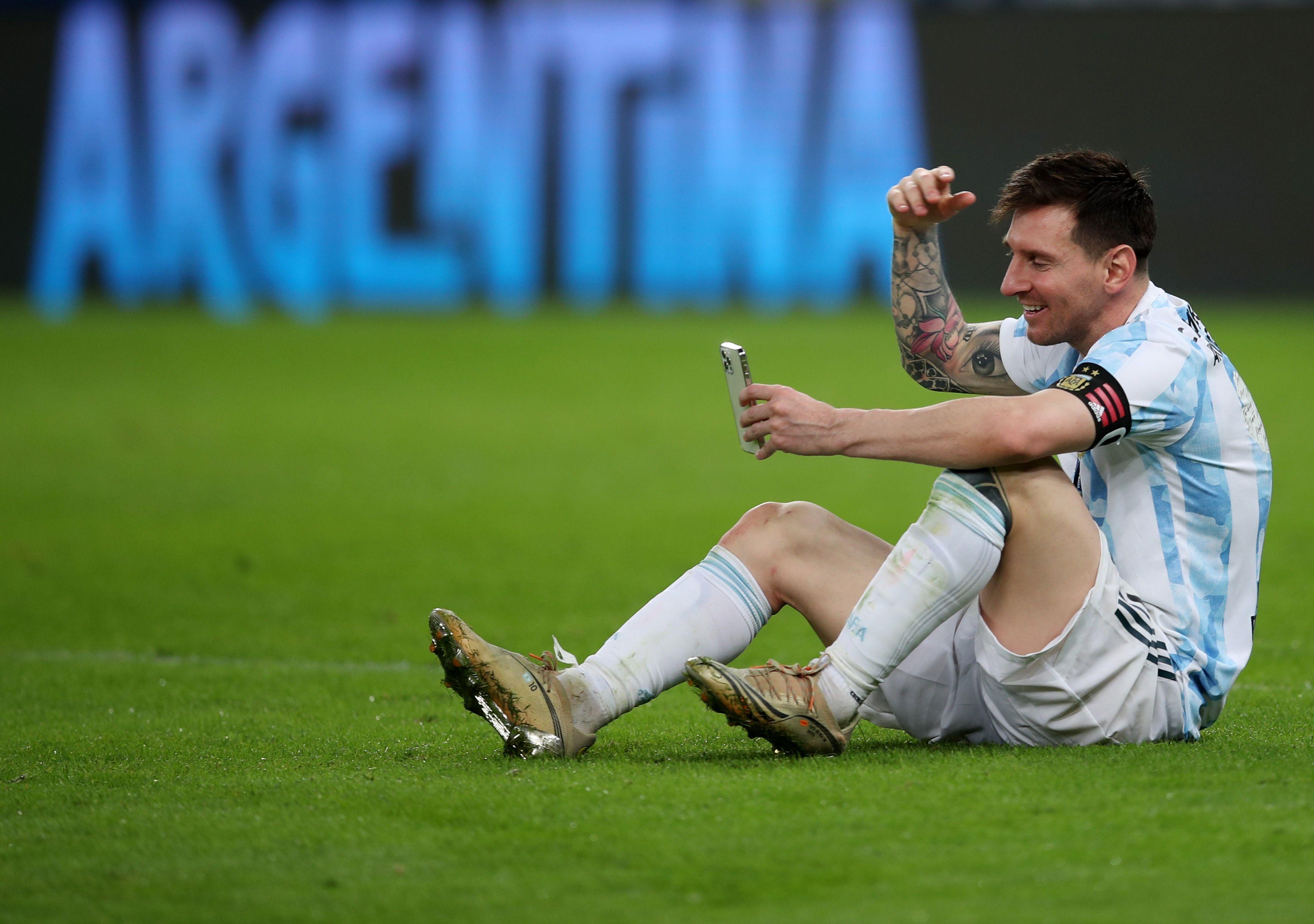 Soccer Football - Copa America  2021 - Final - Brazil v Argentina - Estadio Maracana, Rio de Janeiro, Brazil - July 10, 2021 Argentina's Lionel Messi in a video-call at the pitch after winning the Copa America REUTERS/Ricardo Moraes