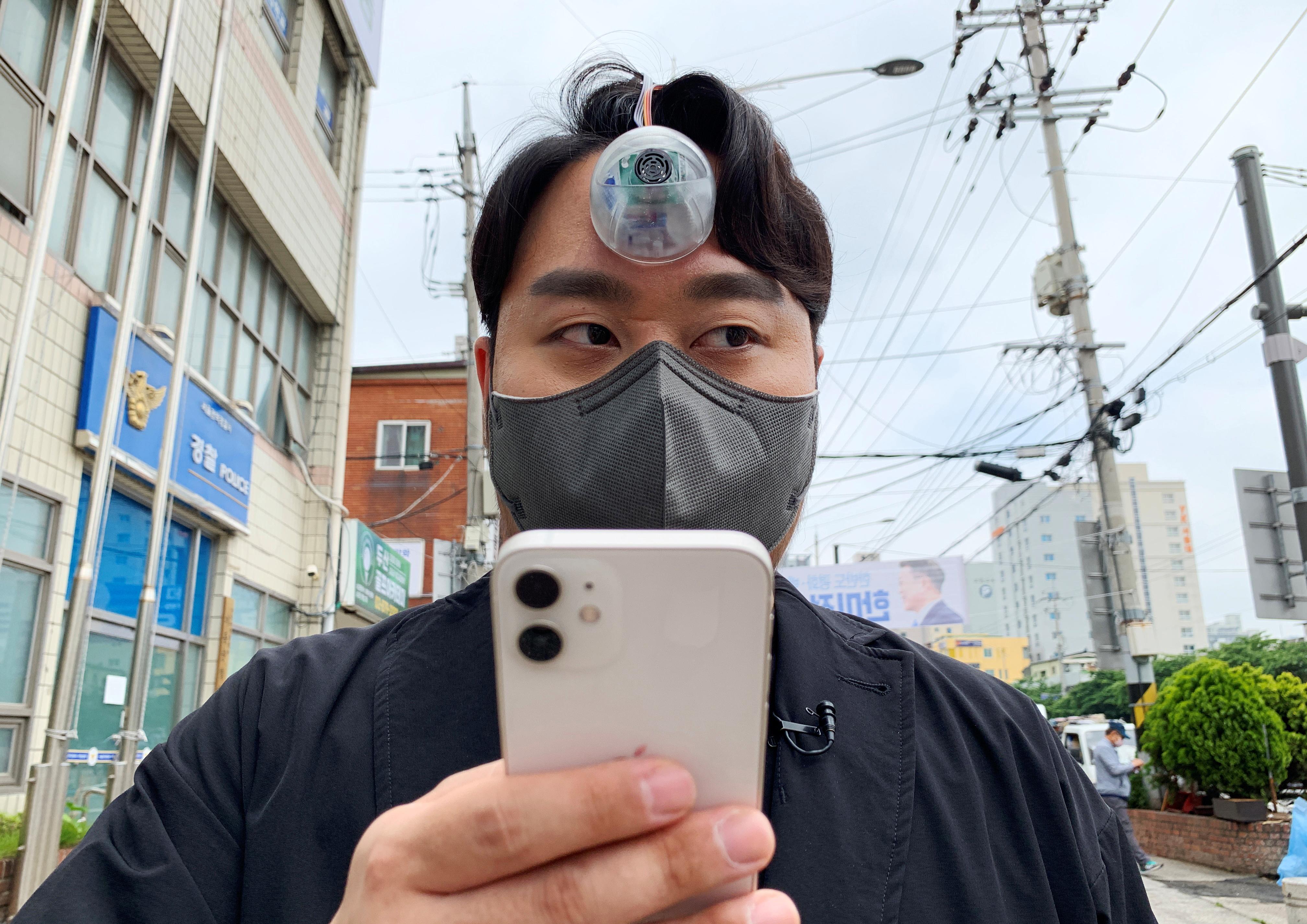South Korean industrial designer Paeng Min-wook shows a robot eye, called