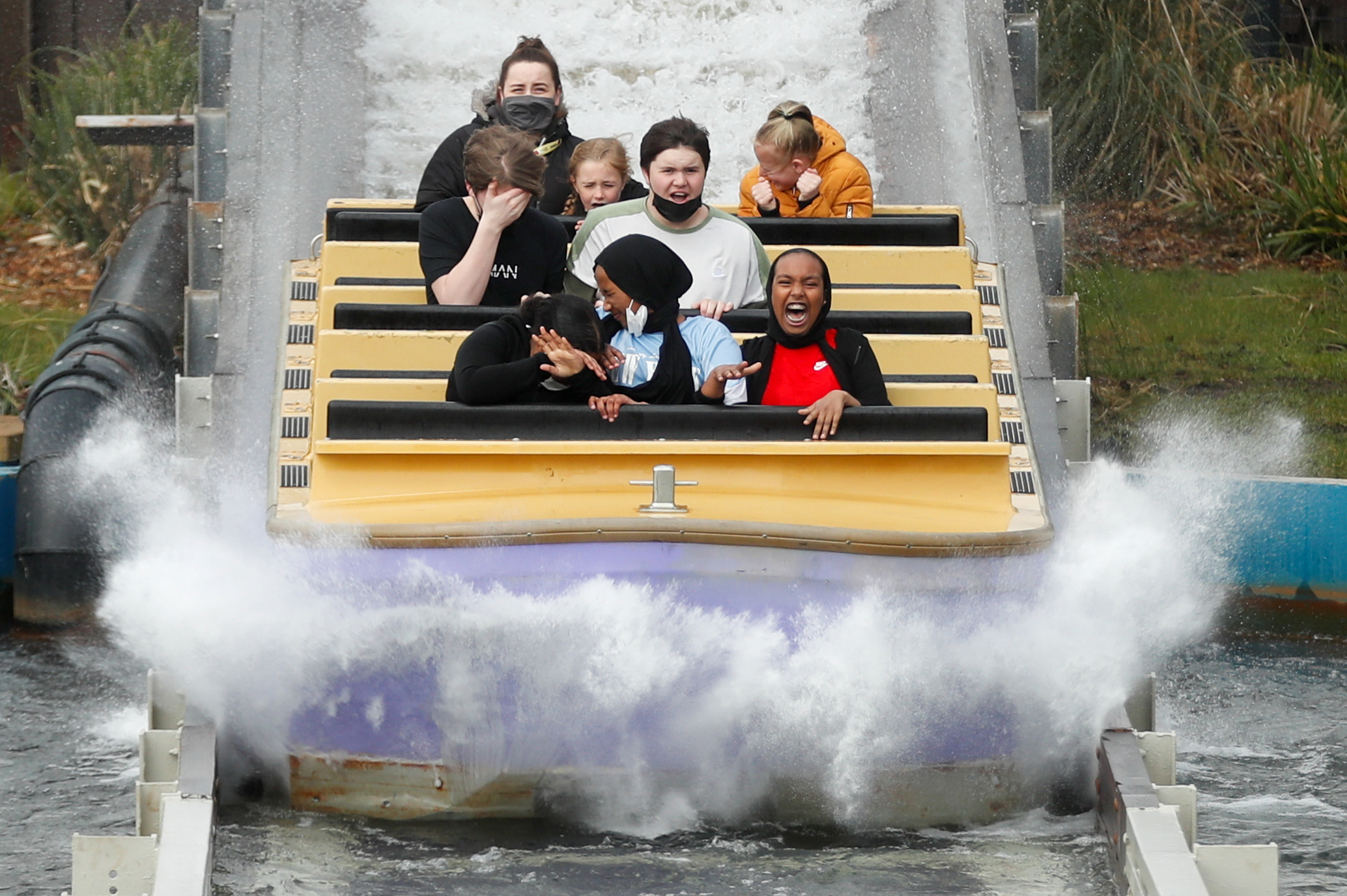 People react while on a ride as Thorpe Park reopens following easing of the coronavirus disease (COVID-19) restrictions, in London, Britain April 12, 2021. REUTERS/Matthew Childs