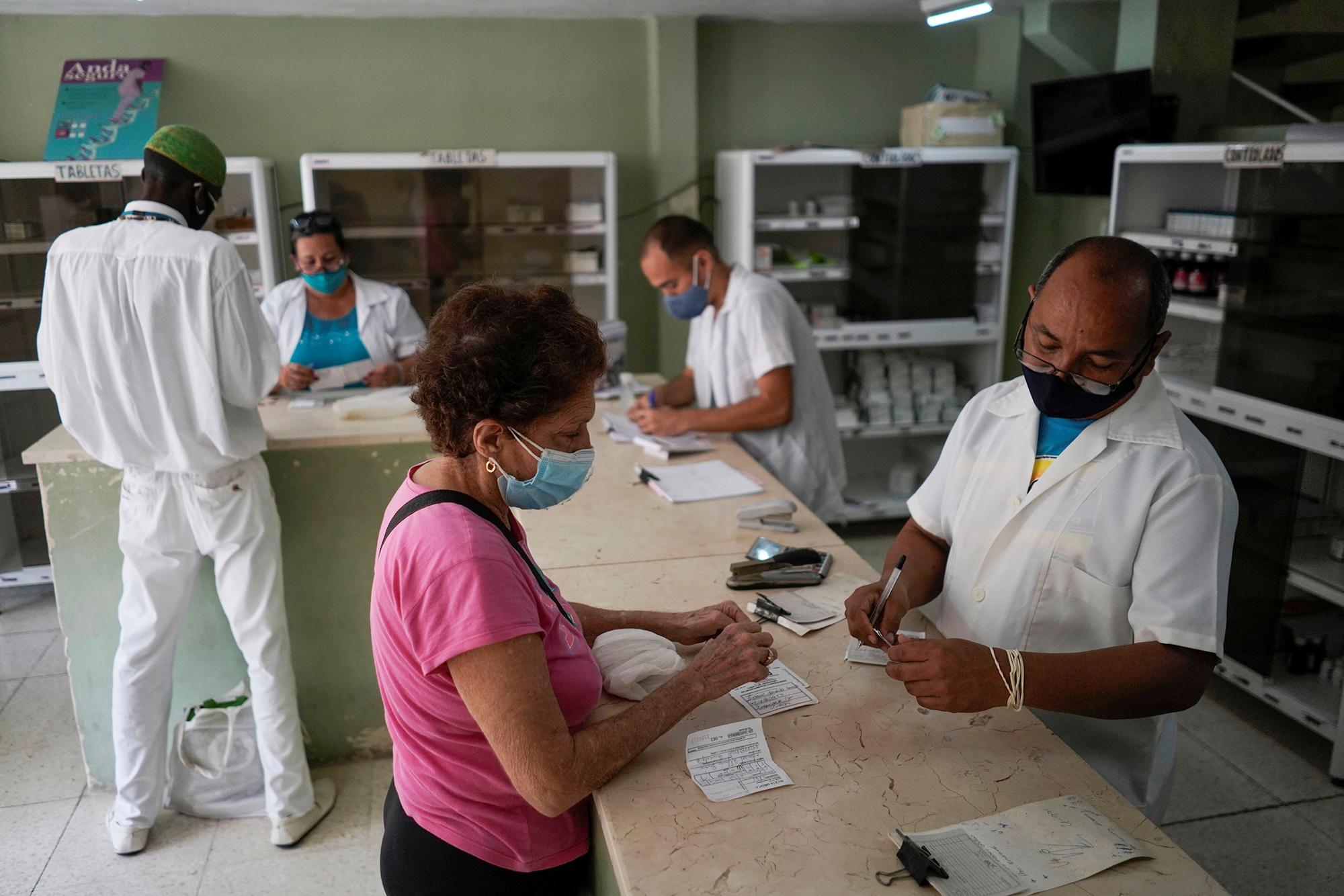A client buys medicine in a pharmacy in Havana, Cuba, April 9, 2021. Picture taken on April 9, 2021. REUTERS/Alexandre Meneghini
