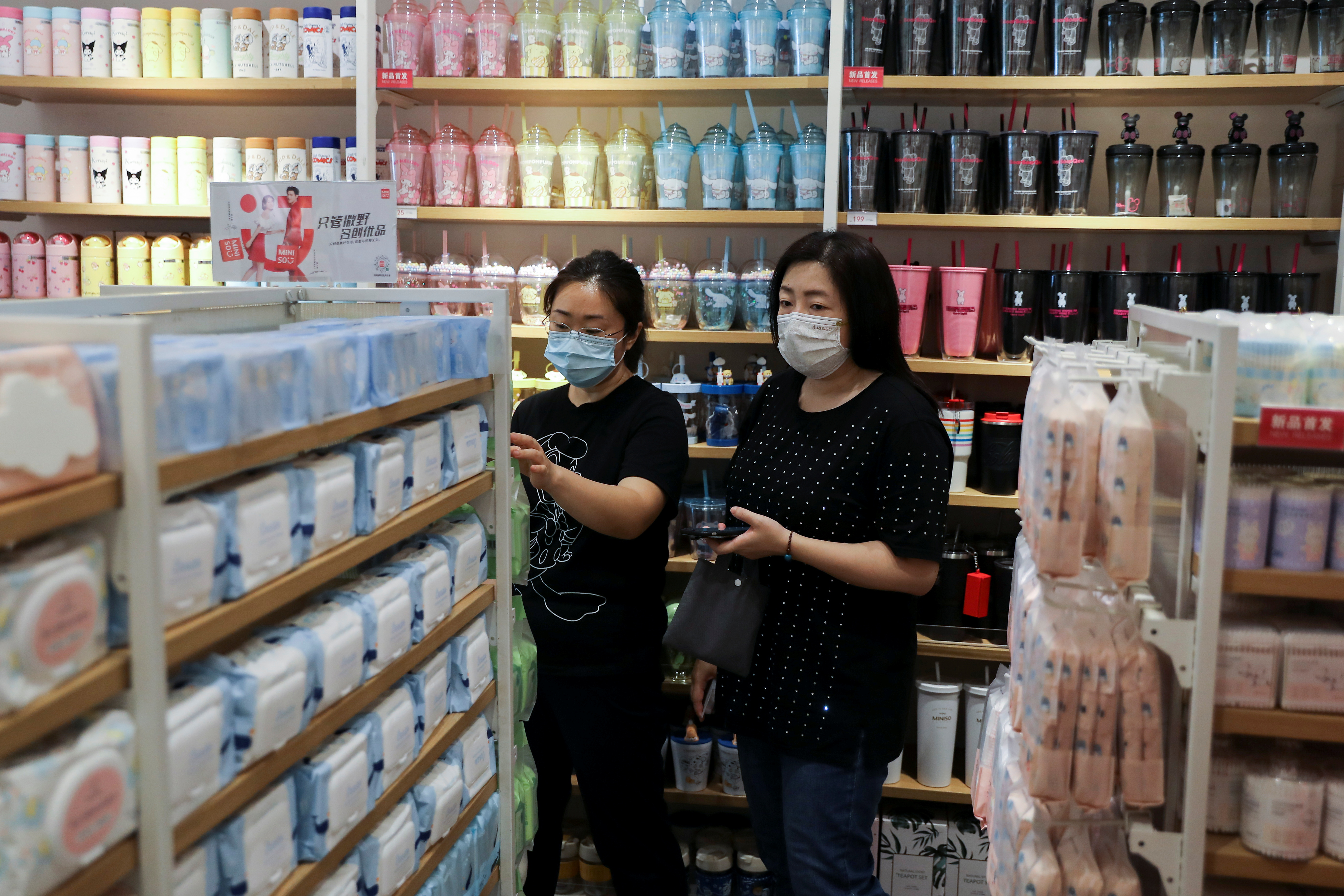 Customers shop at a store of Chinese retailer MINISO Group in Beijing, China September 13, 2021. REUTERS/Tingshu Wang