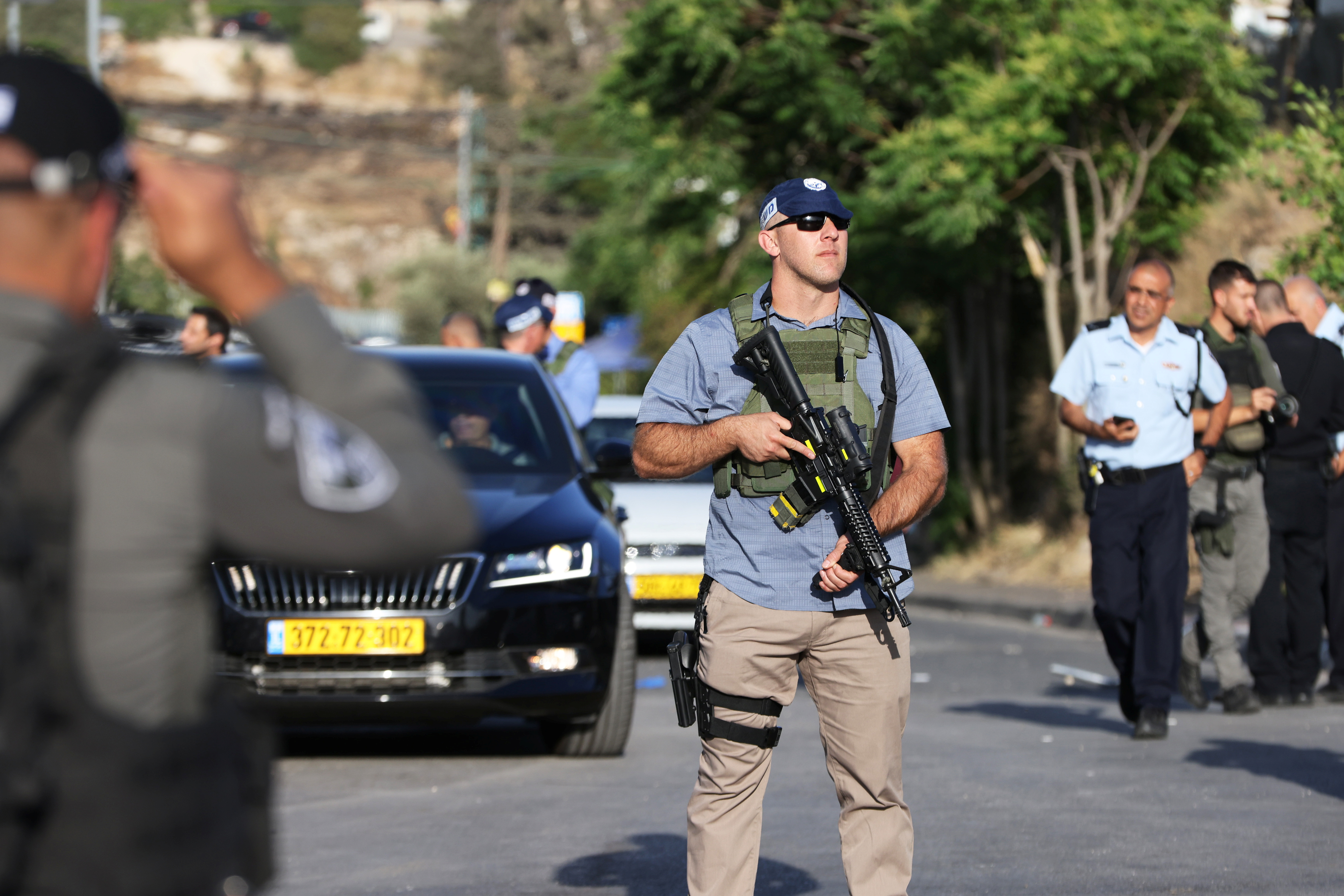 An Israeli security force member stands guard at the scene of what police said was a suspected car-ramming attack, at the entrance to Sheikh Jarrah neighbourhood of East Jerusalem May 16, 2021. REUTERS/Ronen Zvulun