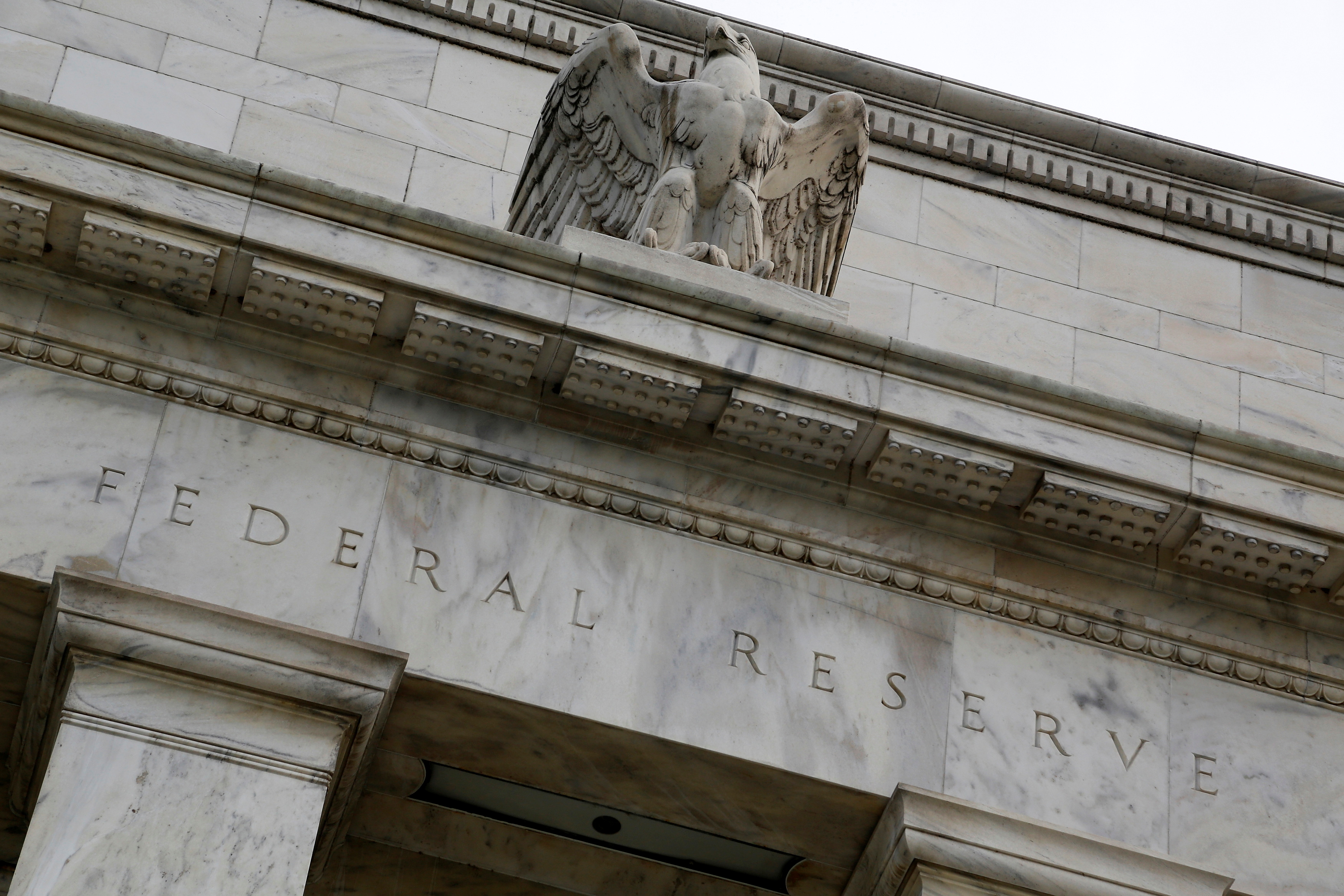 An eagle tops the U.S. Federal Reserve building's facade in Washington, July 31, 2013. REUTERS/Jonathan Ernst