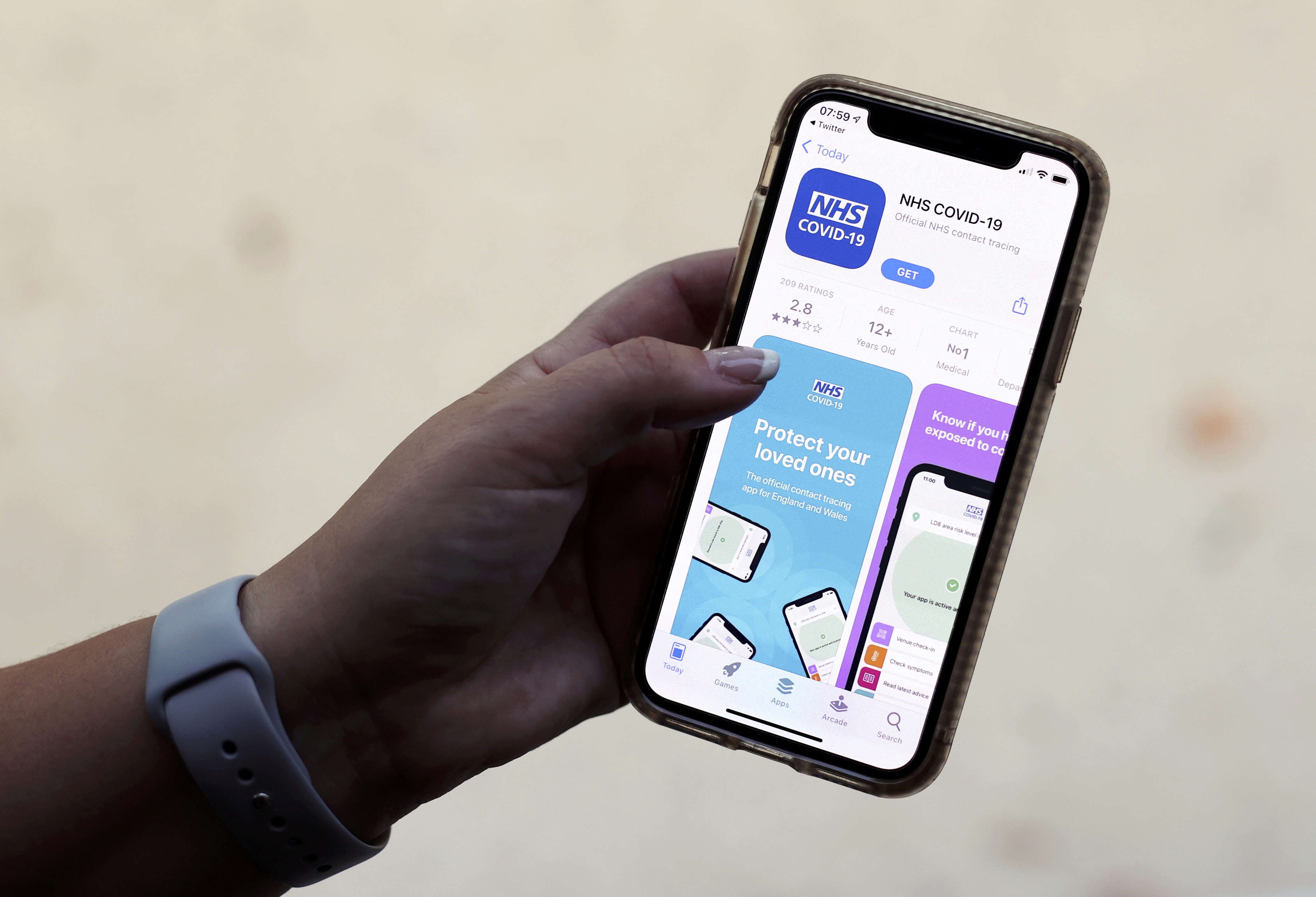 The coronavirus disease (COVID-19) contact tracing smartphone app of Britain's National Health Service (NHS) is displayed on an iPhone in this illustration photograph taken in Keele, Britain, September 24, 2020. REUTERS/Carl Recine/Illustration/File Photo