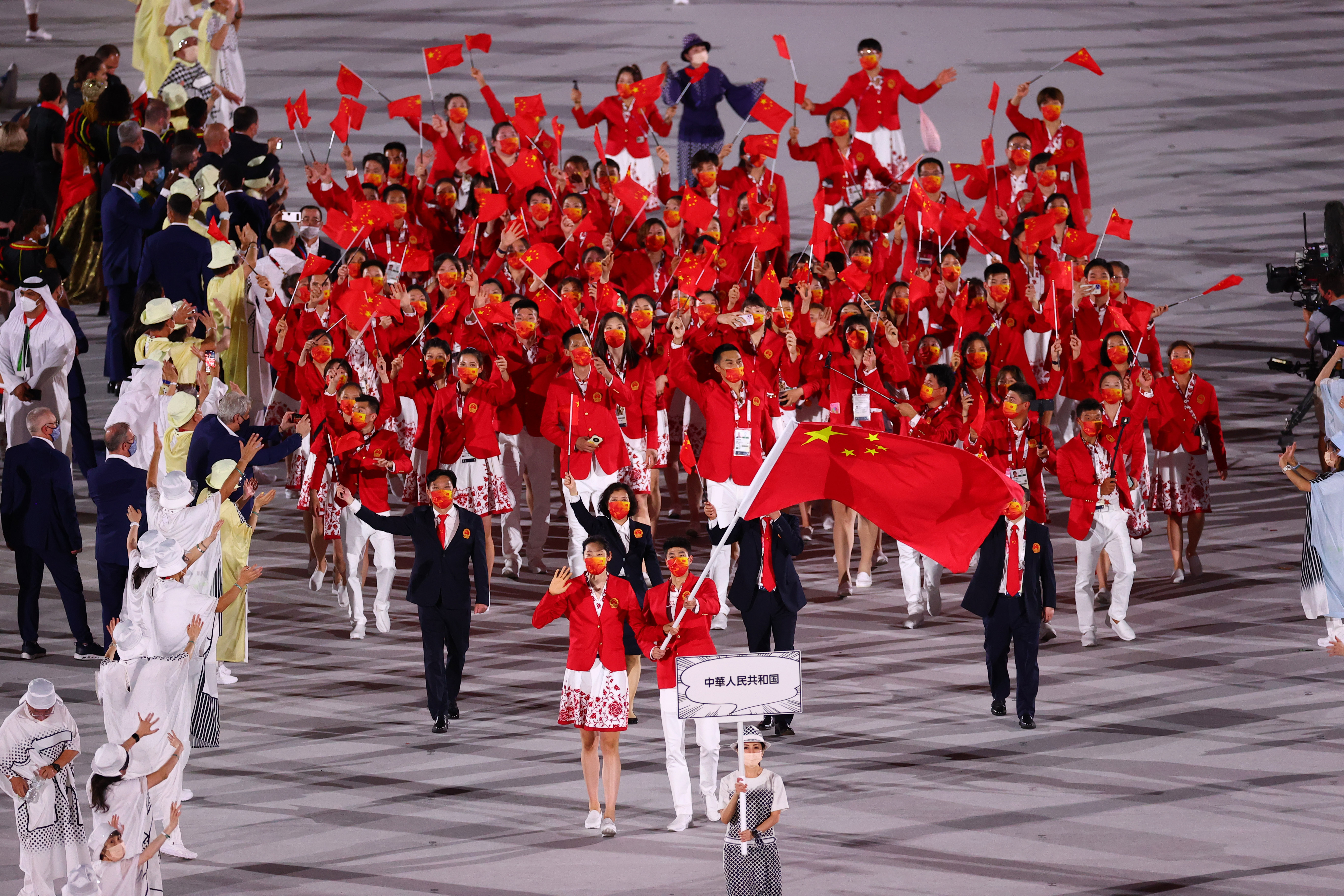 Tokyo 2020 Olympics - The Tokyo 2020 Olympics Opening Ceremony - Olympic Stadium, Tokyo, Japan - July 23, 2021. Flag bearers Zhao Shuai of China and Ting Zhu of China lead their contingent during the athletes parade at the opening ceremony REUTERS/Mike Blake