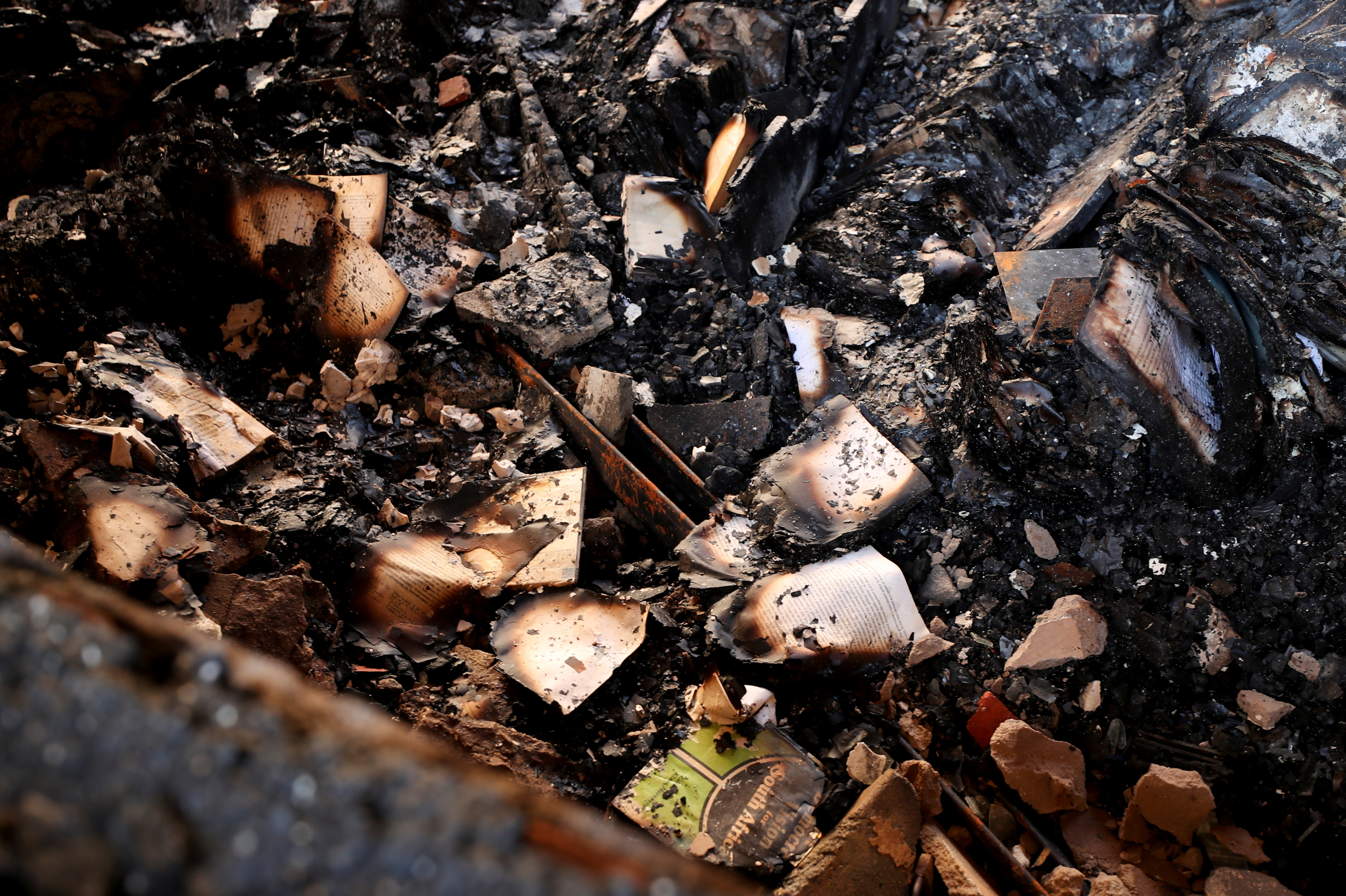 Burnt books are seen in the burnt out remains of Jagger Library at the University of Cape Town in Cape Town, South Africa, April 20, 2021. REUTERS/Mike Hutchings