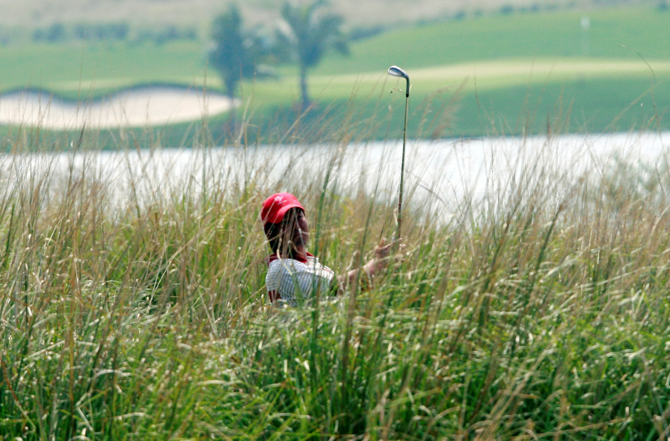 Asia's Hideto Tanihara of Japan hits the ball on the fourth hole during the second day of foursomes competition against Europe at the Royal Trophy golf tournament in Chonburi province, near Bangkok, January 10, 2009. REUTERS/Sukree Sukplang (THAILAND)/File Photo