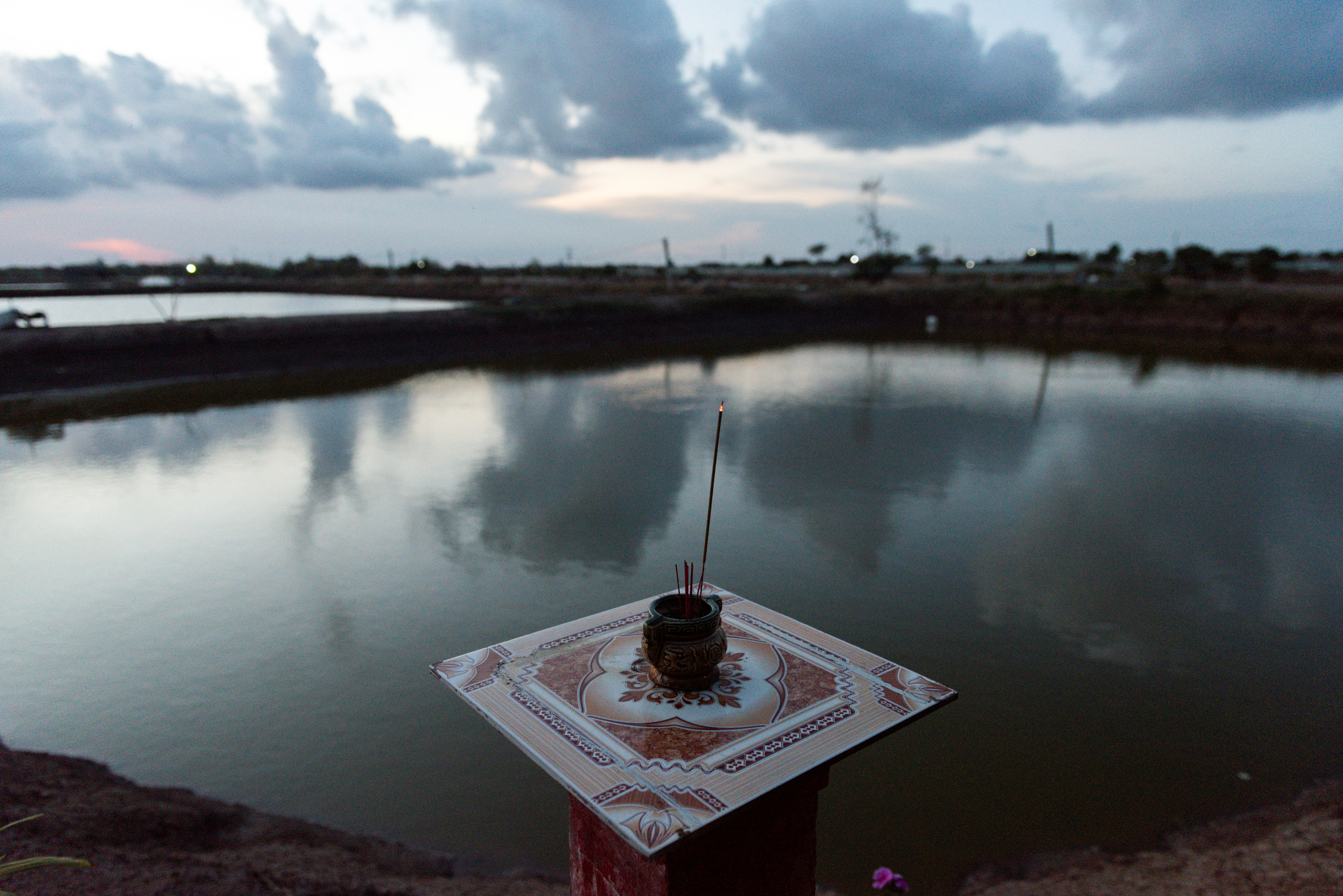 An altar is seen in front of a shrimp farm pool in Soc Trang province, Vietnam, May 1, 2021. Picture Taken May 1, 2021. REUTERS/Thanh Hue
