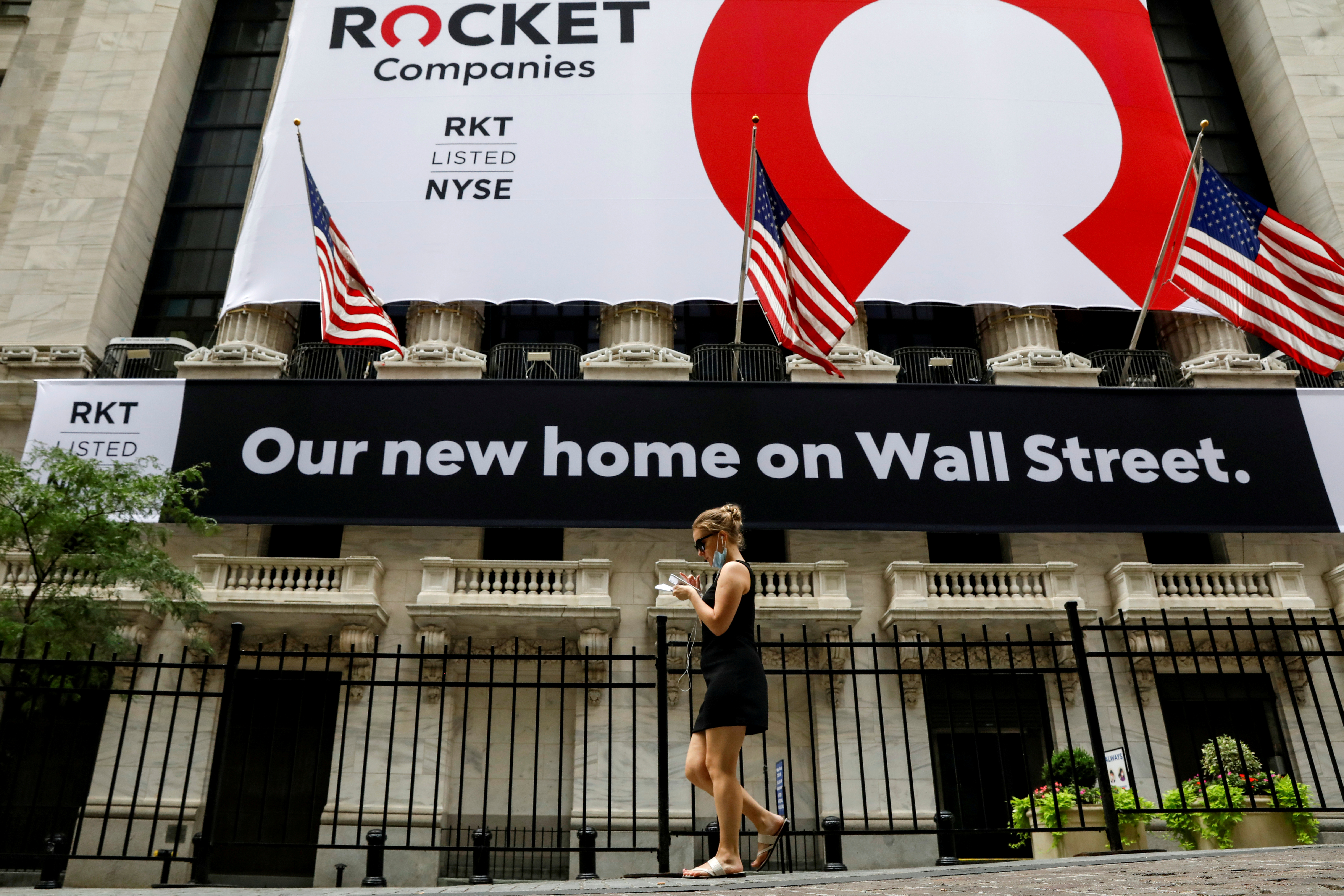 A banner celebrating Rocket Companies Inc., the parent company of U.S. mortgage lender Quicken Loans, IPO is seen on the front facade of the New York Stock Exchange (NYSE) in New York City, U.S., August 6, 2020. REUTERS/Brendan McDermid