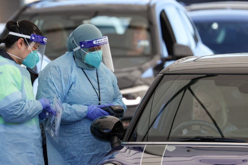 Medical workers administer tests at the Bondi Beach drive-through coronavirus disease (COVID-19) testing centre in the wake of new positive cases in Sydney, Australia, June 17, 2021.  REUTERS/Loren Elliott/File Photo