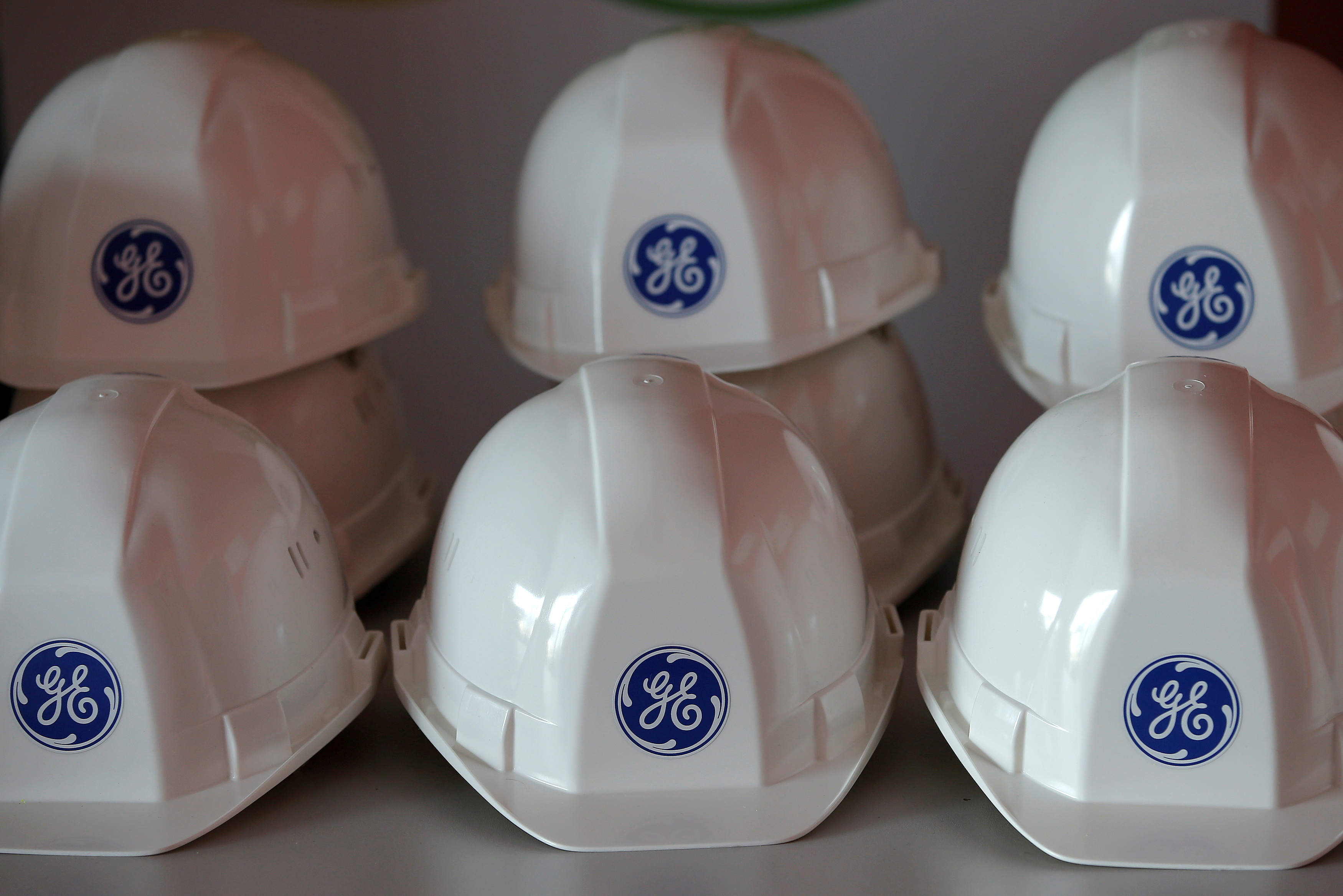 The General Electric logo is pictured on working helmets during a visit at the General Electric offshore wind turbine plant in Montoir-de-Bretagne, near Saint-Nazaire, western France, November 21, 2016. REUTERS/Stephane Mahe/File Photo