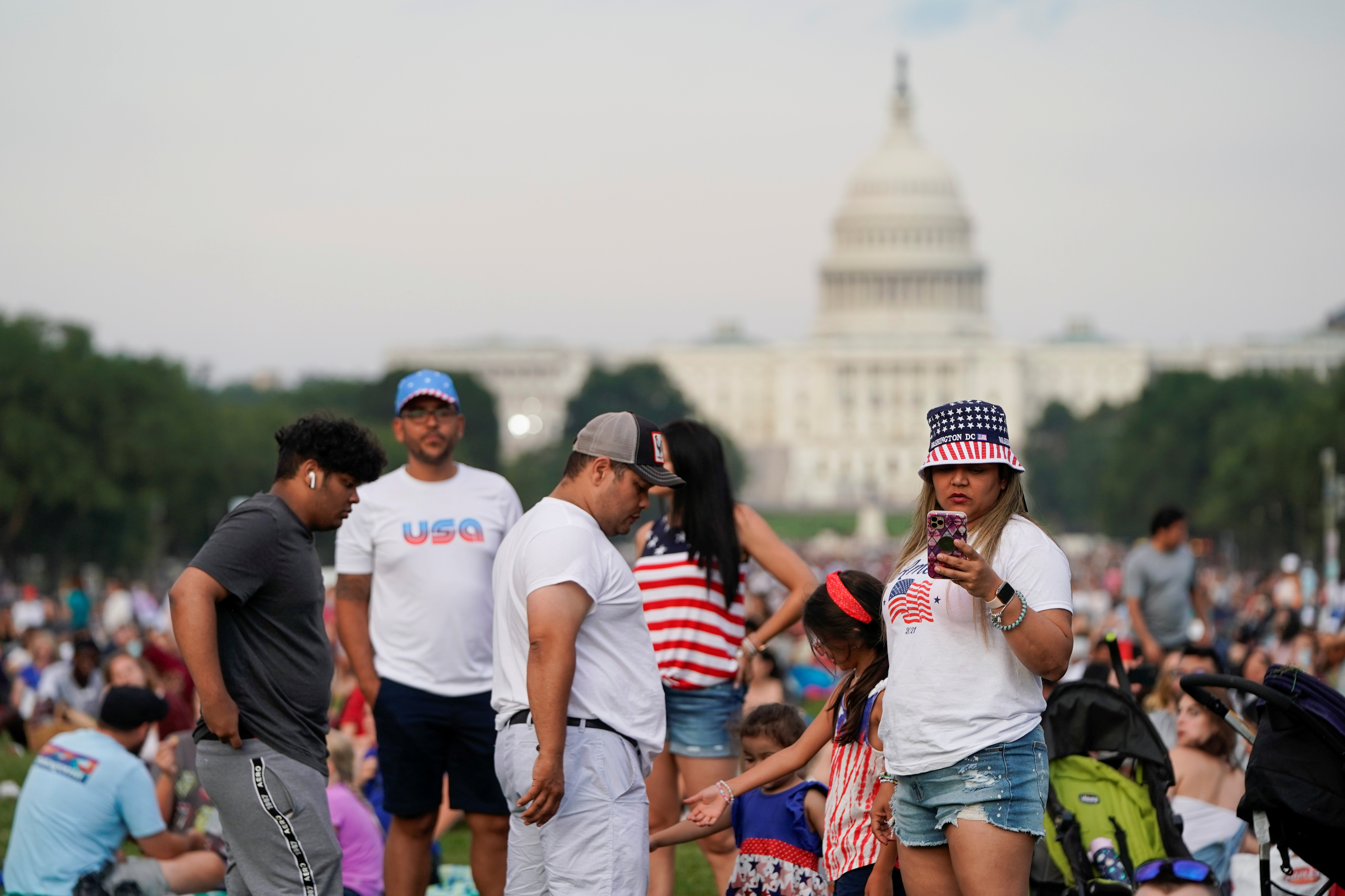 People gather for the annual Independence Day fireworks celebration at the National Mall in Washington, U.S., July 4, 2021.  REUTERS/Joshua Roberts