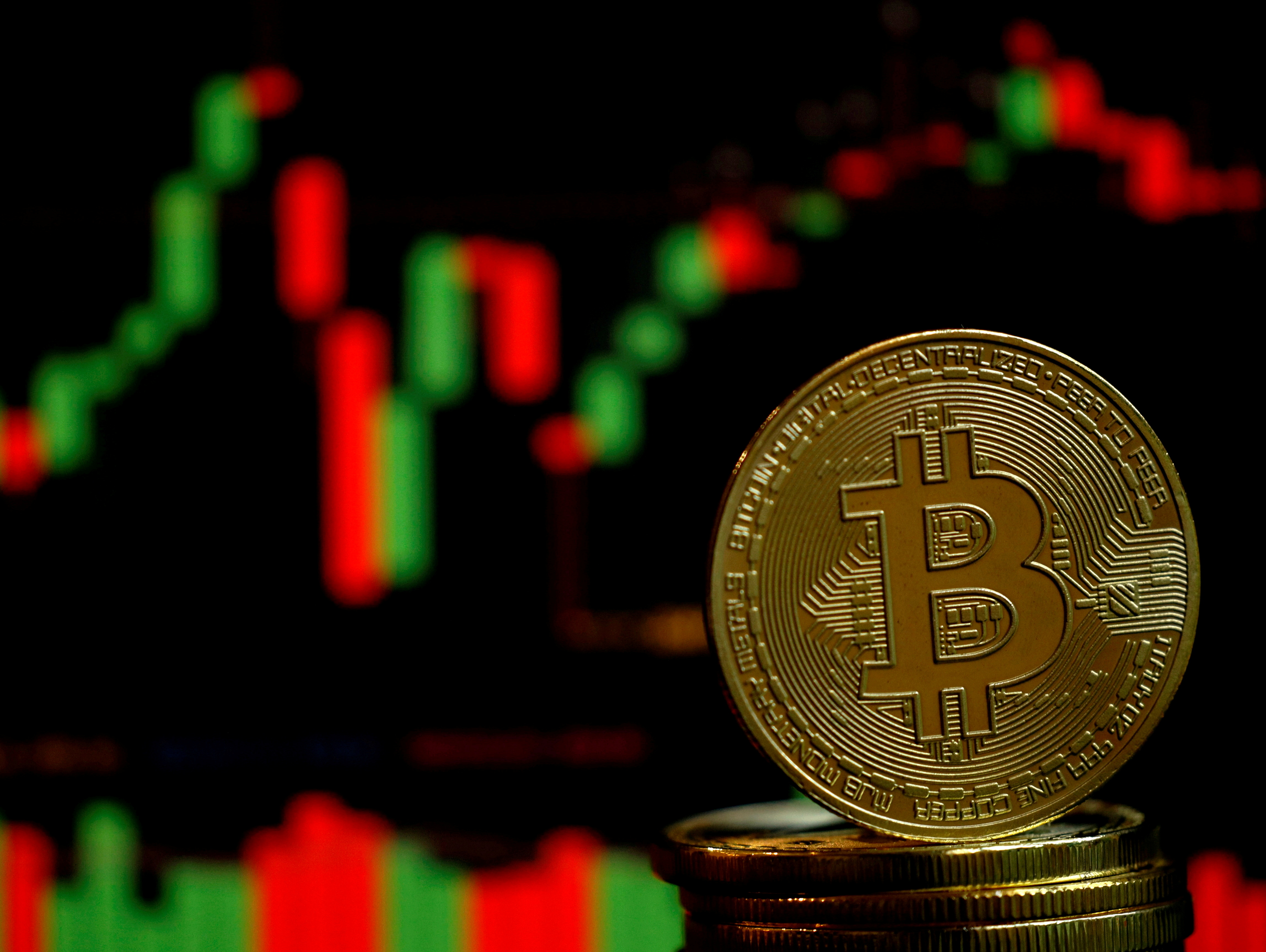 A representation of the virtual cryptocurrency Bitcoin is seen in this picture illustration taken June 14, 2021.  REUTERS/Edgar Su/Illustration/File Photo