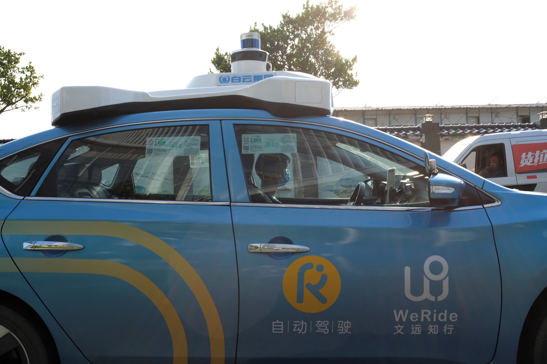 A WeRide autonomous taxi is seen in Guangzhou, Guangdong province, China May 15, 2020. Picture taken May 15, 2020. REUTERS/Yilei Sun/Files