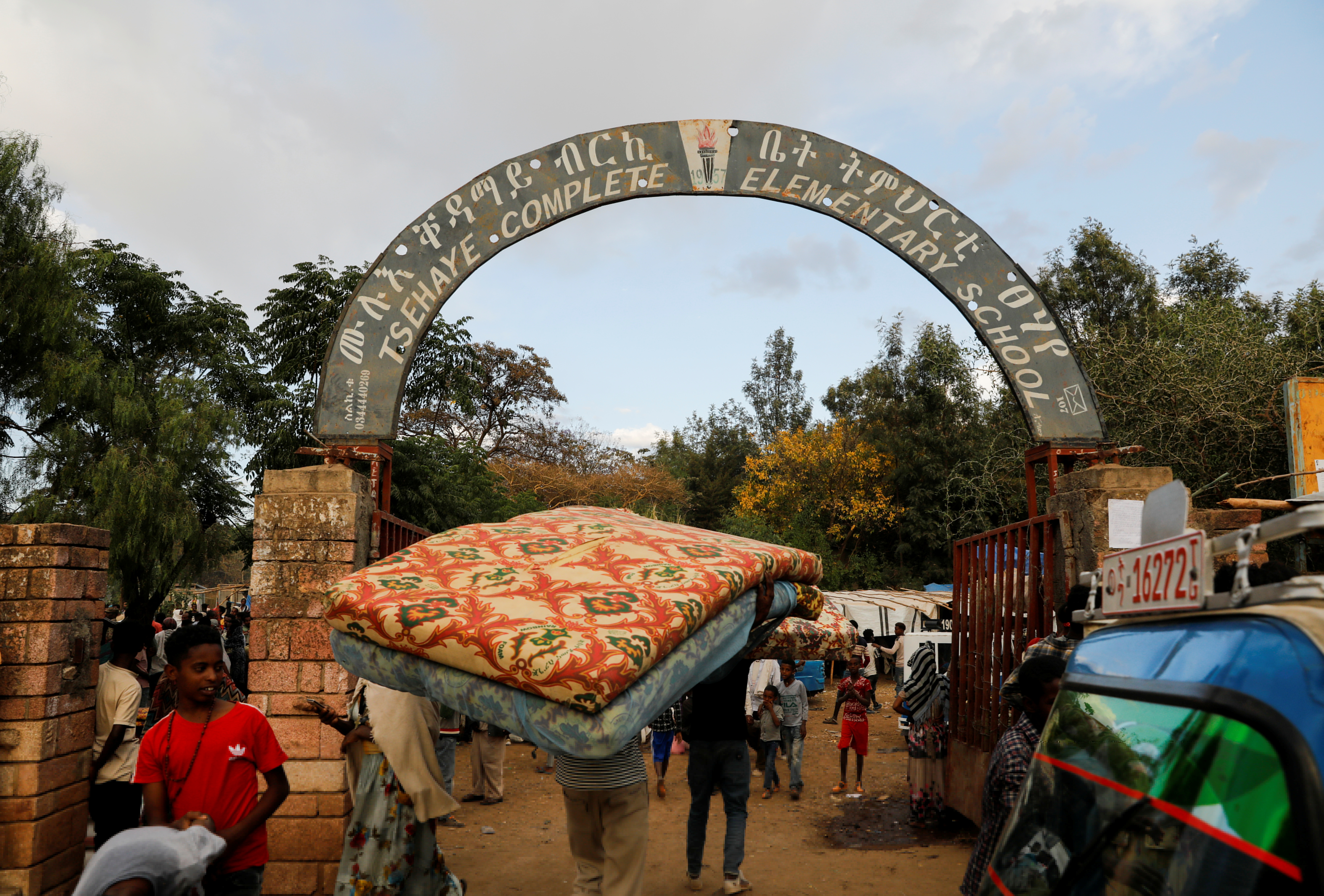 A man carries a mattress into the Tsehaye primary school, which was turned into a temporary shelter for people displaced by conflict, in the town of Shire, Tigray region, Ethiopia, March 15, 2021. REUTERS/Baz Ratner
