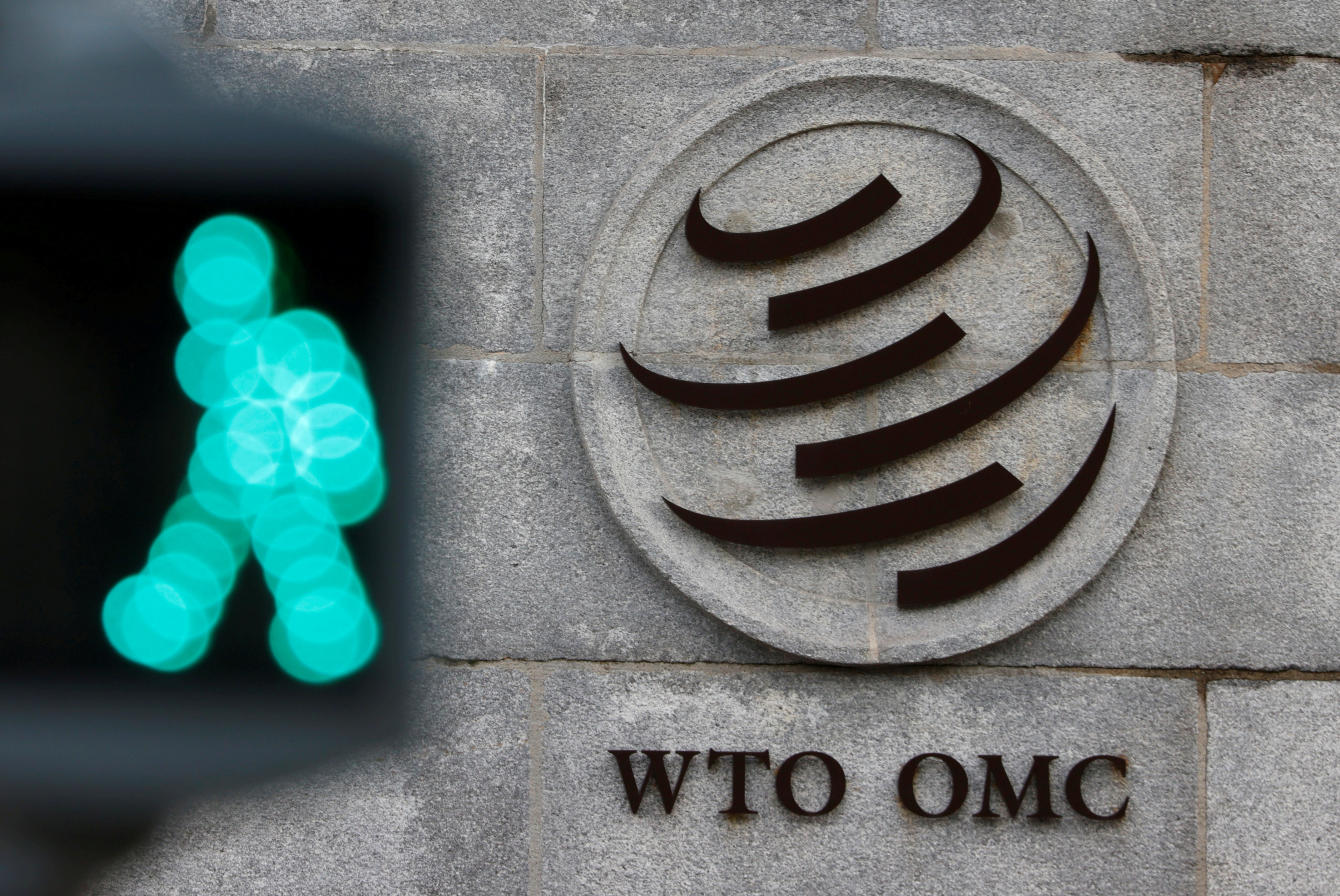 The  World Trade Organization (WTO) logo is pictured in front of their headquarters in Geneva, Switzerland, October 28, 2020. REUTERS/Denis Balibouse