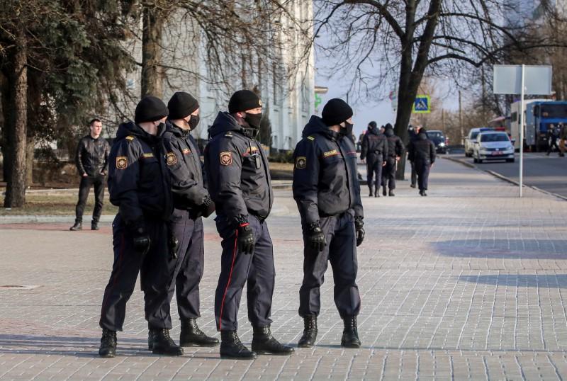 Belarusian law enforcement officers stand guard in a street in Minsk, Belarus March 25, 2021. BelaPAN via REUTERS/File Photo