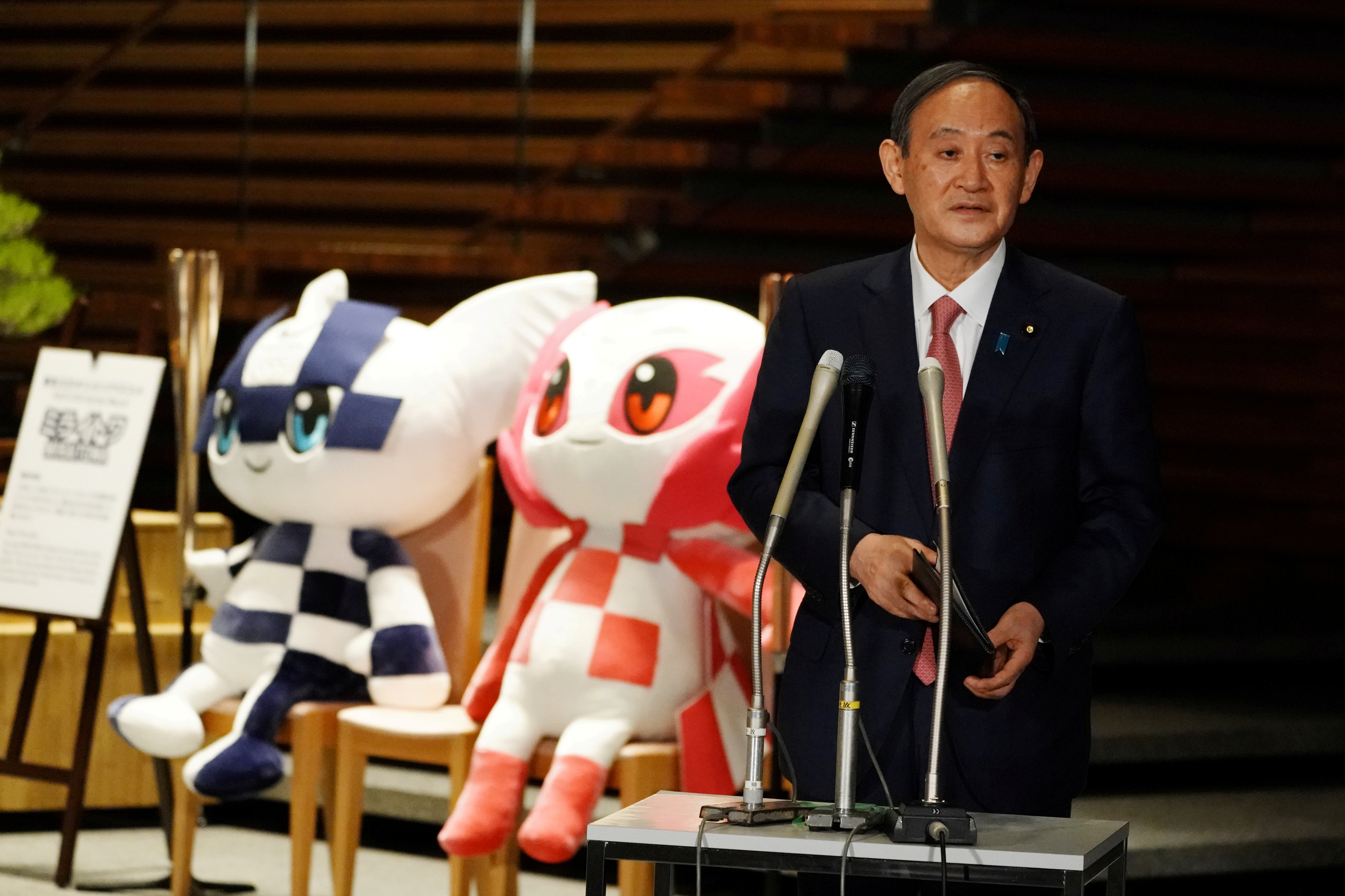 Japanese Prime Minister Yoshihide Suga, next to the mascots of Tokyo 2020 Olympic and Paralympic Games, speaks to media after announcing that Tokyo, Kyoto and Okinawa will be applied for pre-emergency status under a new prevention law during a government task force meeting at the prime minister's office in Tokyo, Japan April 9, 2021. Eugene Hoshiko/Pool via REUTESR/File Photo