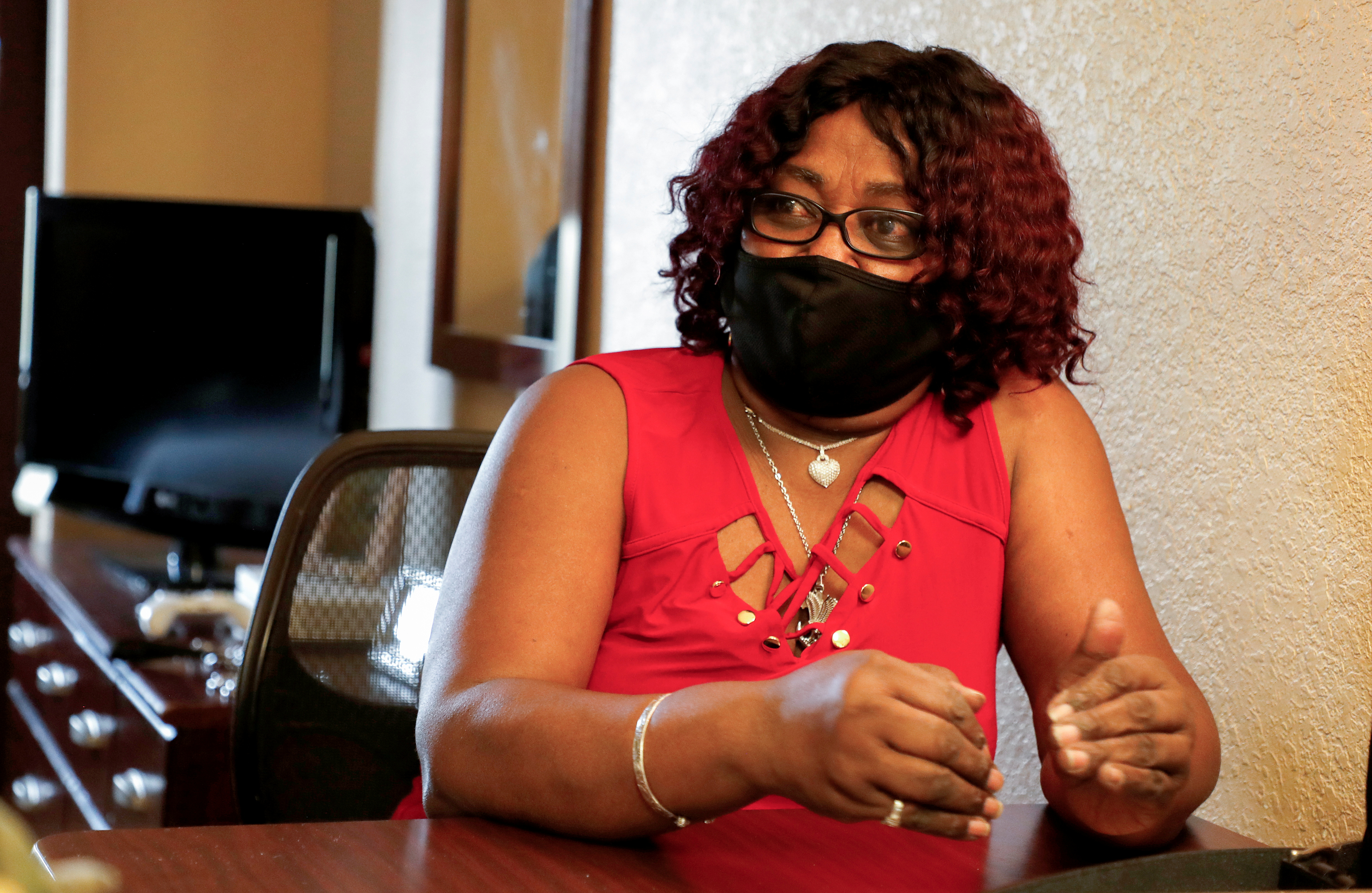 Greyhound Bus driver Marvia Robinson speaks with Reuters in her hotel room in Orlando, Florida, U.S., March 28, 2021. Picture taken March 28, 2021.  REUTERS/Joe Skipper
