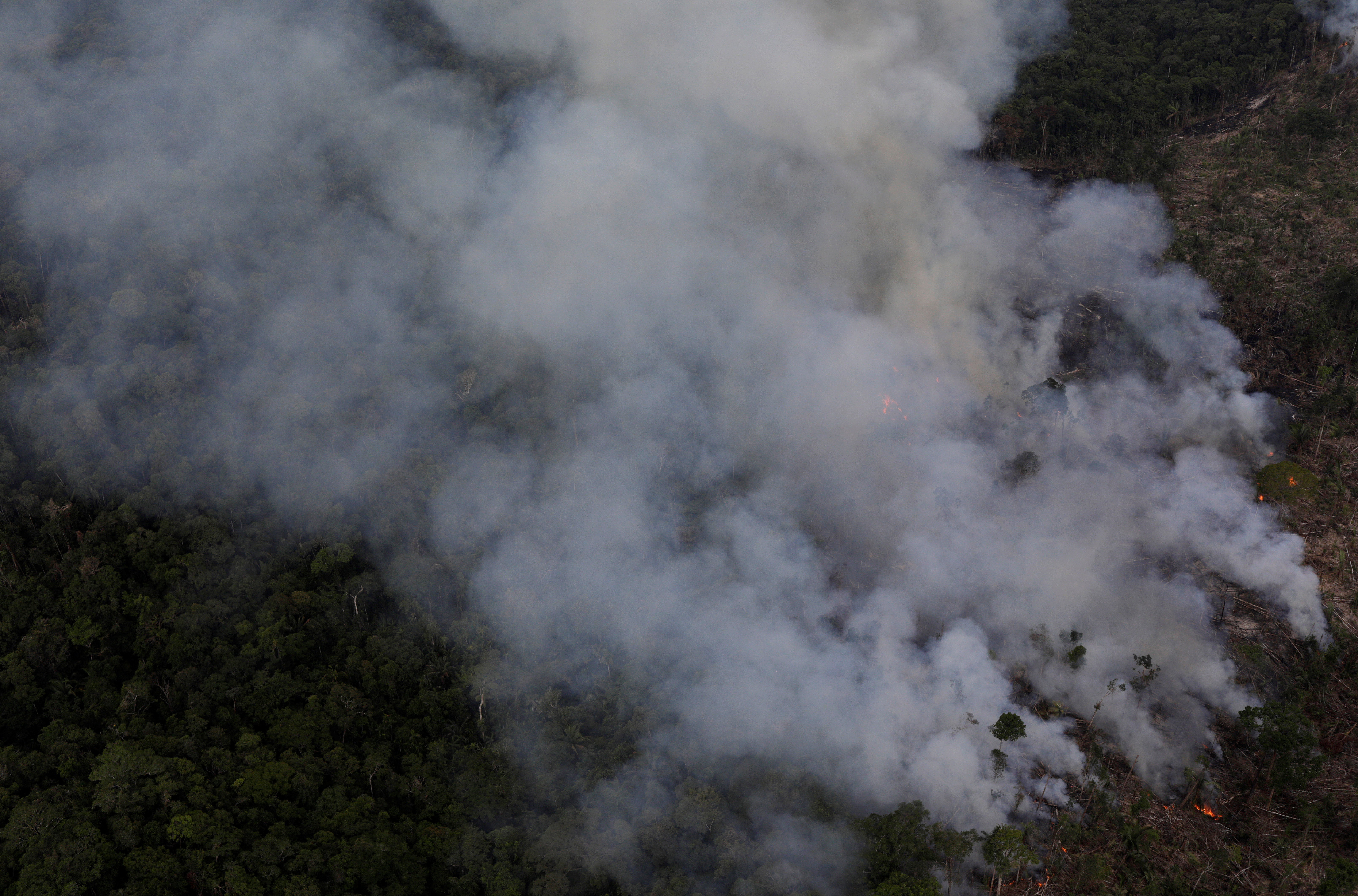 An aerial view of a tract of Amazon jungle burning as it is cleared by farmers in Itaituba, Para, Brazil September 26, 2019.  Picture taken September 26, 2019. REUTERS/Ricardo Moraes